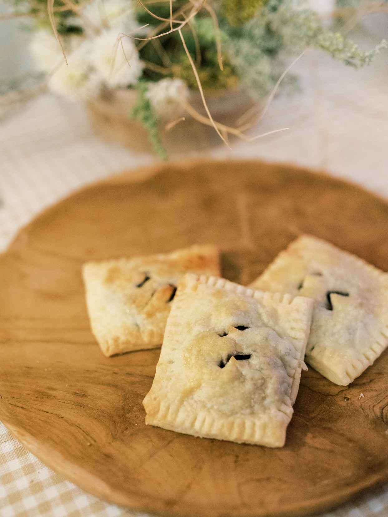small pastries on wooden tray for wedding food