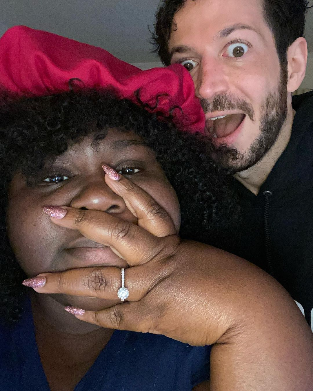 Gabourey Sidibe and Brandon Frankel posing with engagement ring after marriage proposal