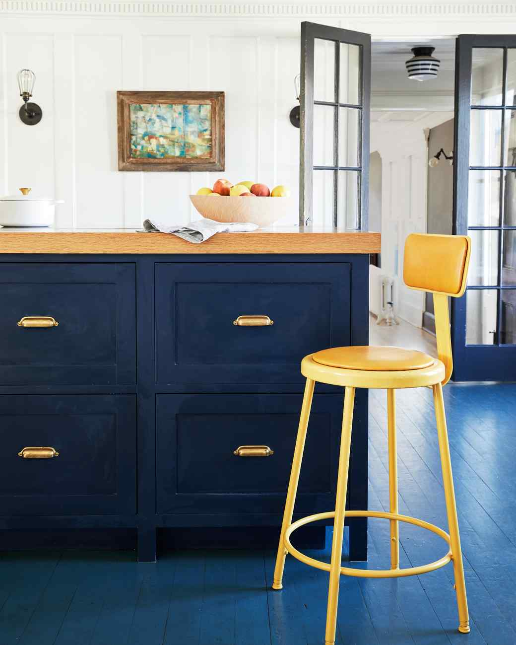 blue painted cabinets yellow stool