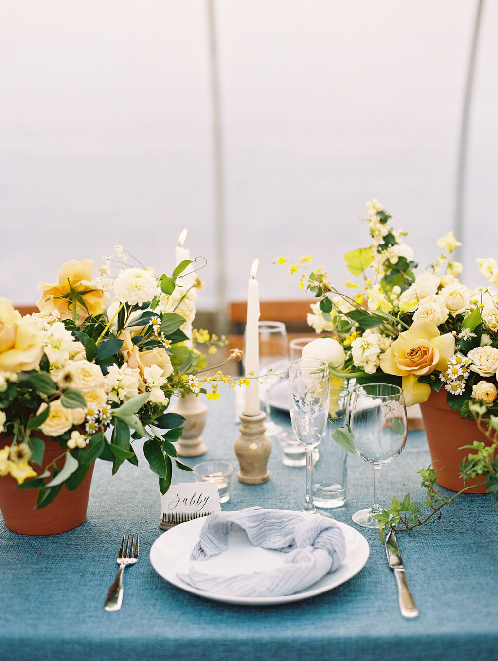 yellow floral wedding reception table centerpieces