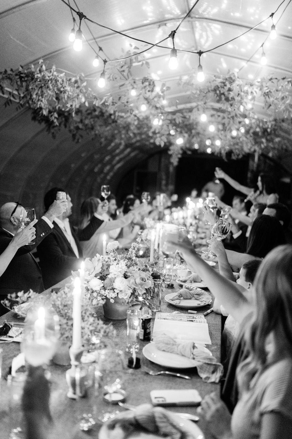 guests cheers to bride and groom during wedding reception