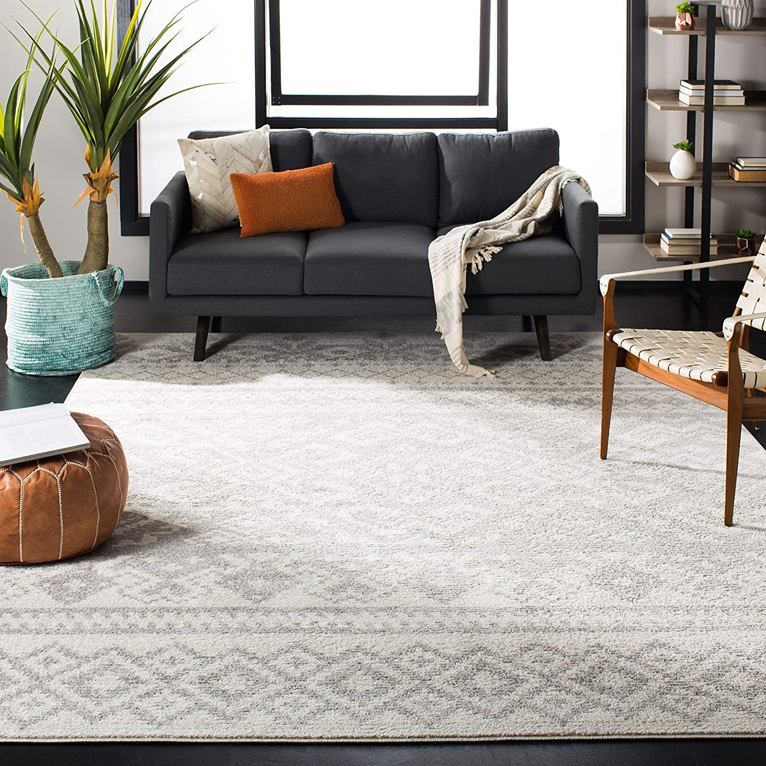 neutral gray and white patterned rug on living room floor