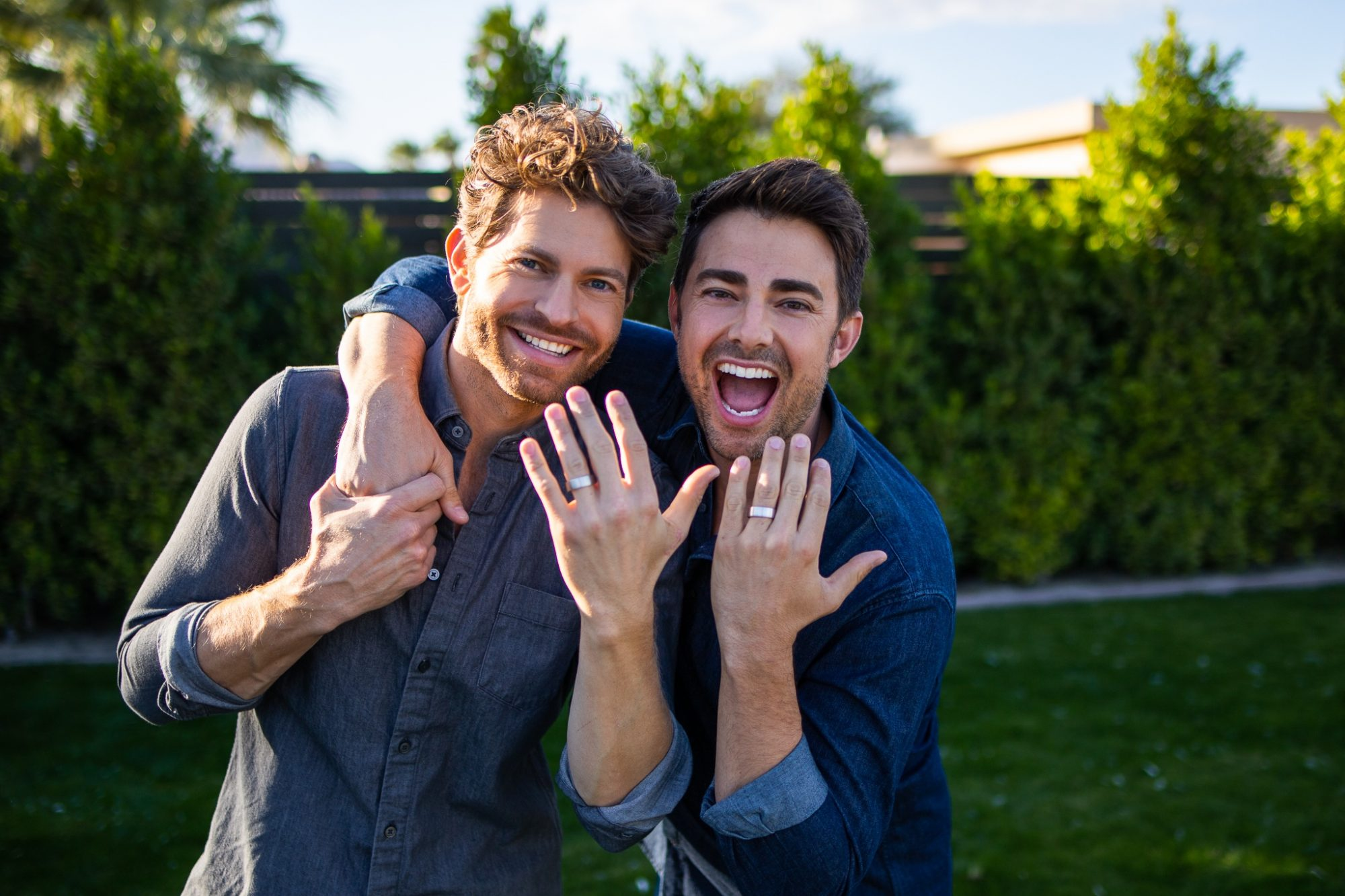 jonathan bennett and jaymes vaughan posing with engagement rings after marriage proposal