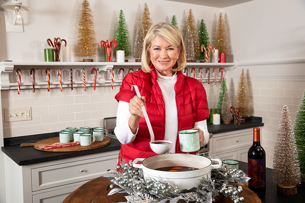 martha stewart serving mulled wine in kitchen with holiday decor