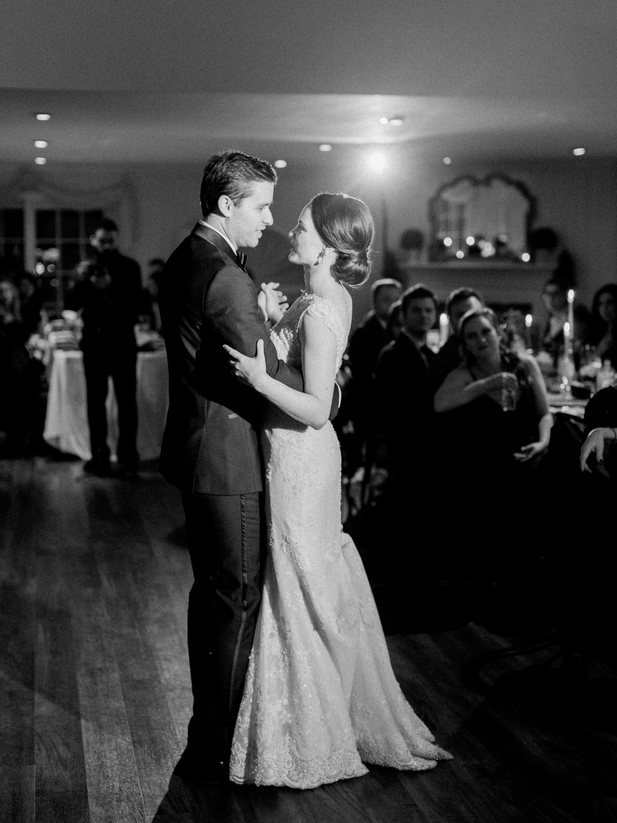 wedding couple first dance under the lights indoors