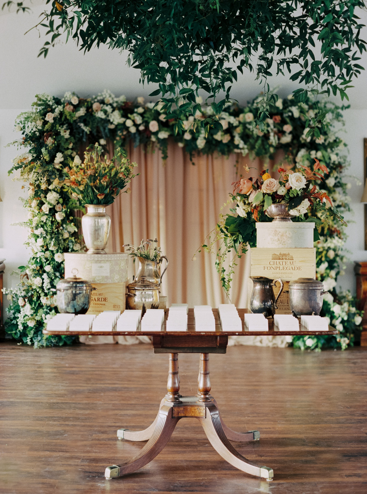 vintage wooden table with seating chart cards