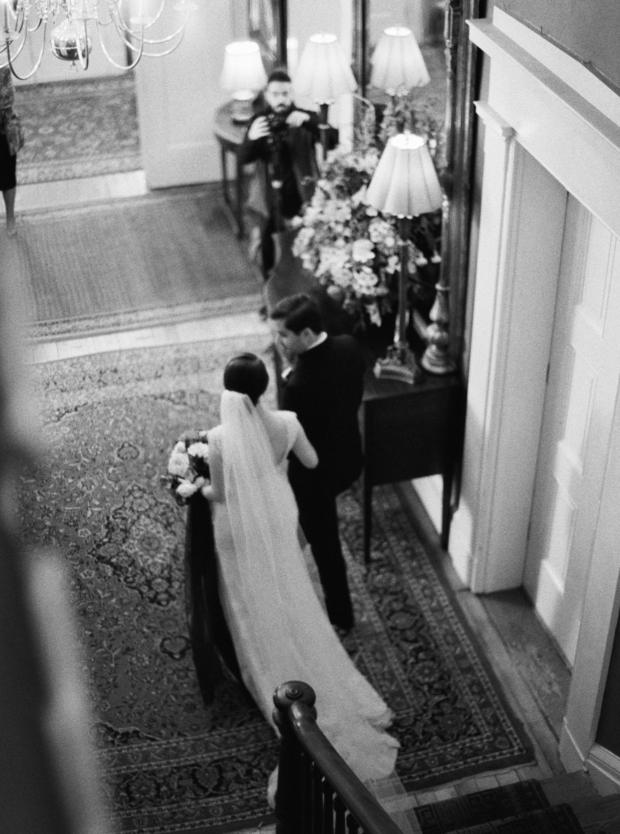 bride and groom at bottom of staircase