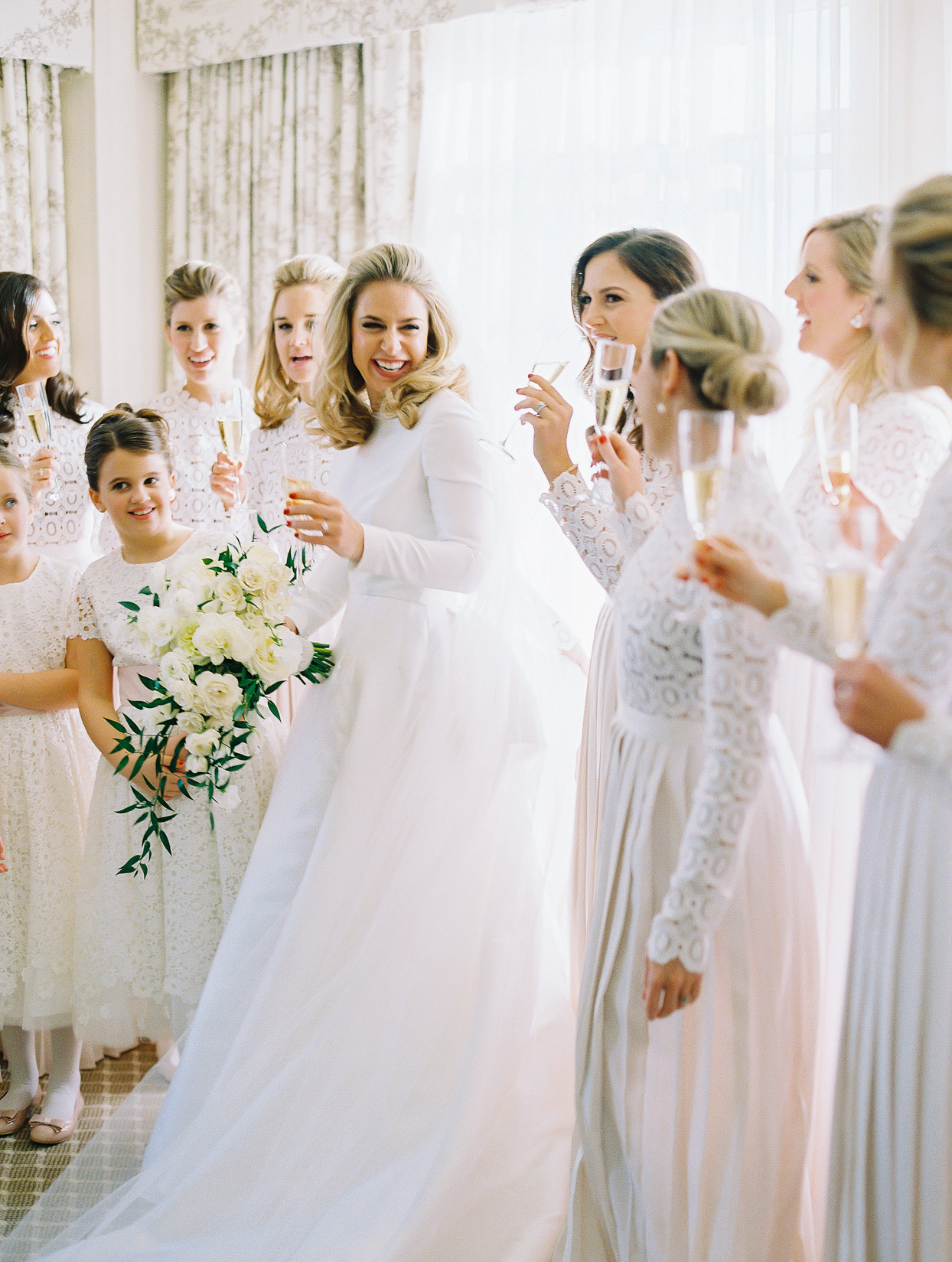 bridesmaids and flower girls in white
