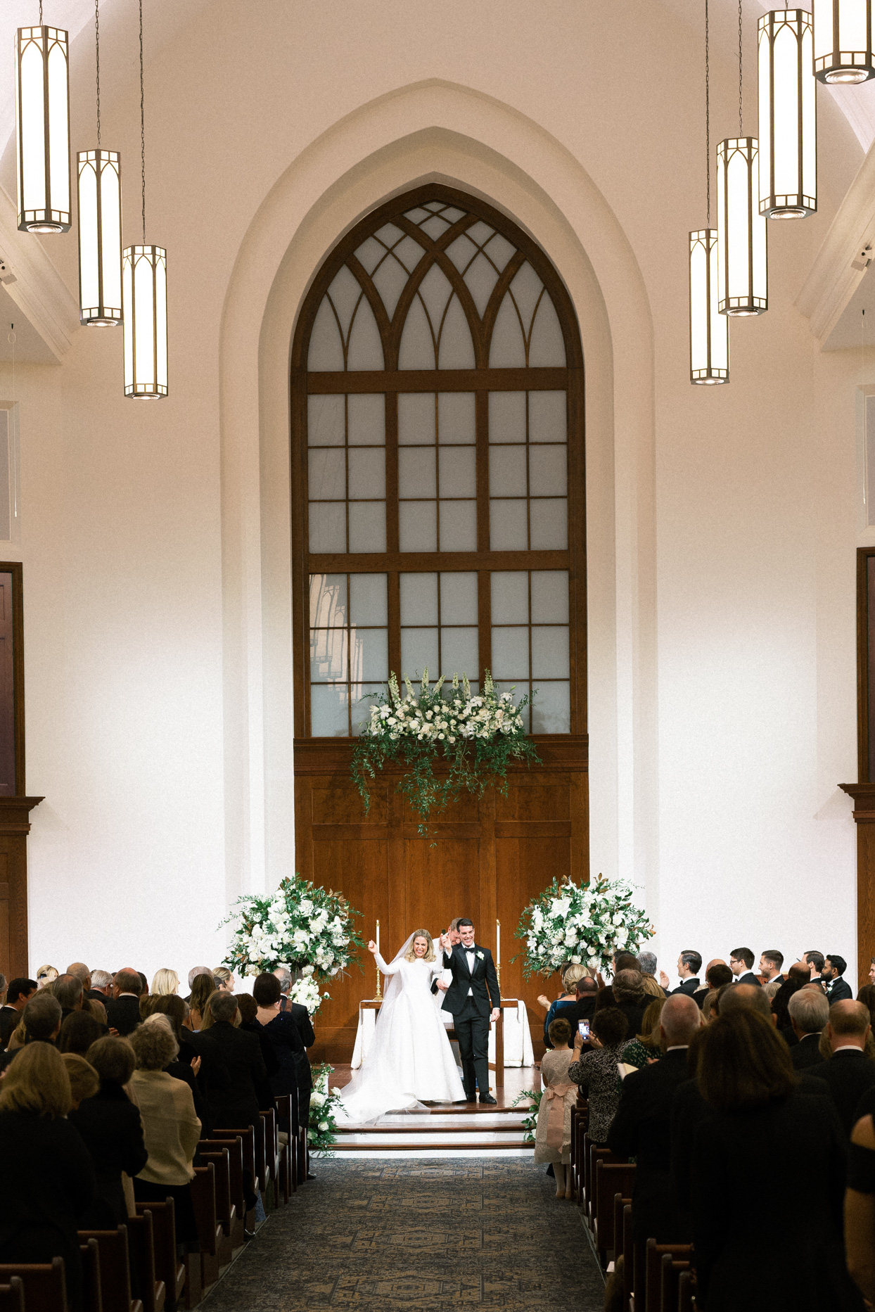 bride and groom celebrating at indoor church wedding