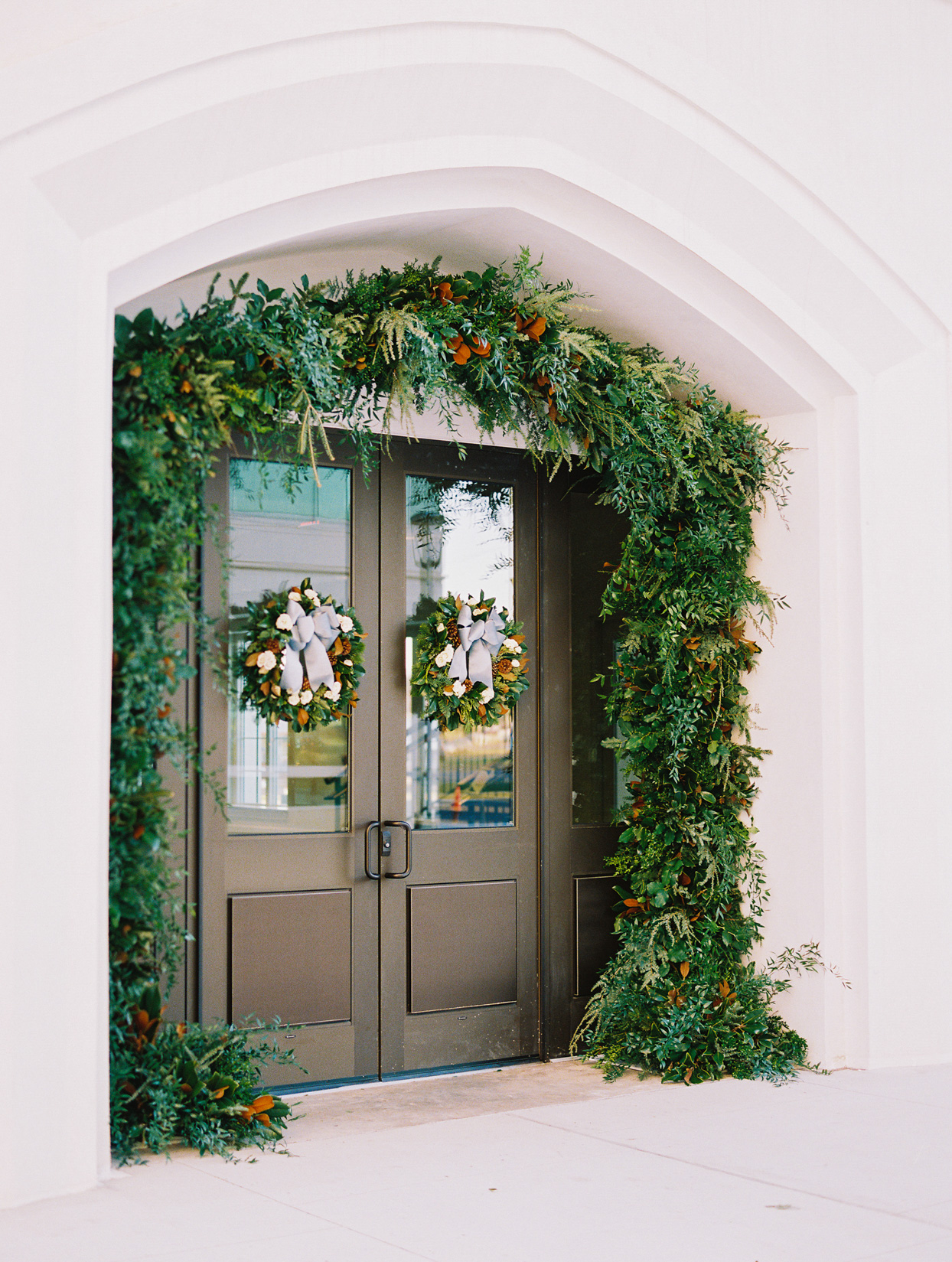 wreaths and floral garland over doorway