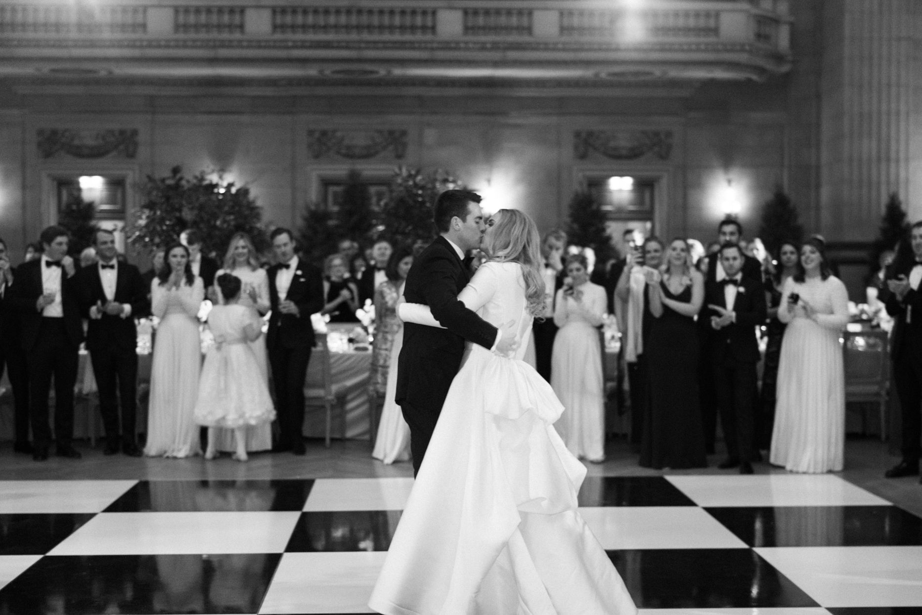 couple kissing during first dance on checkered floor