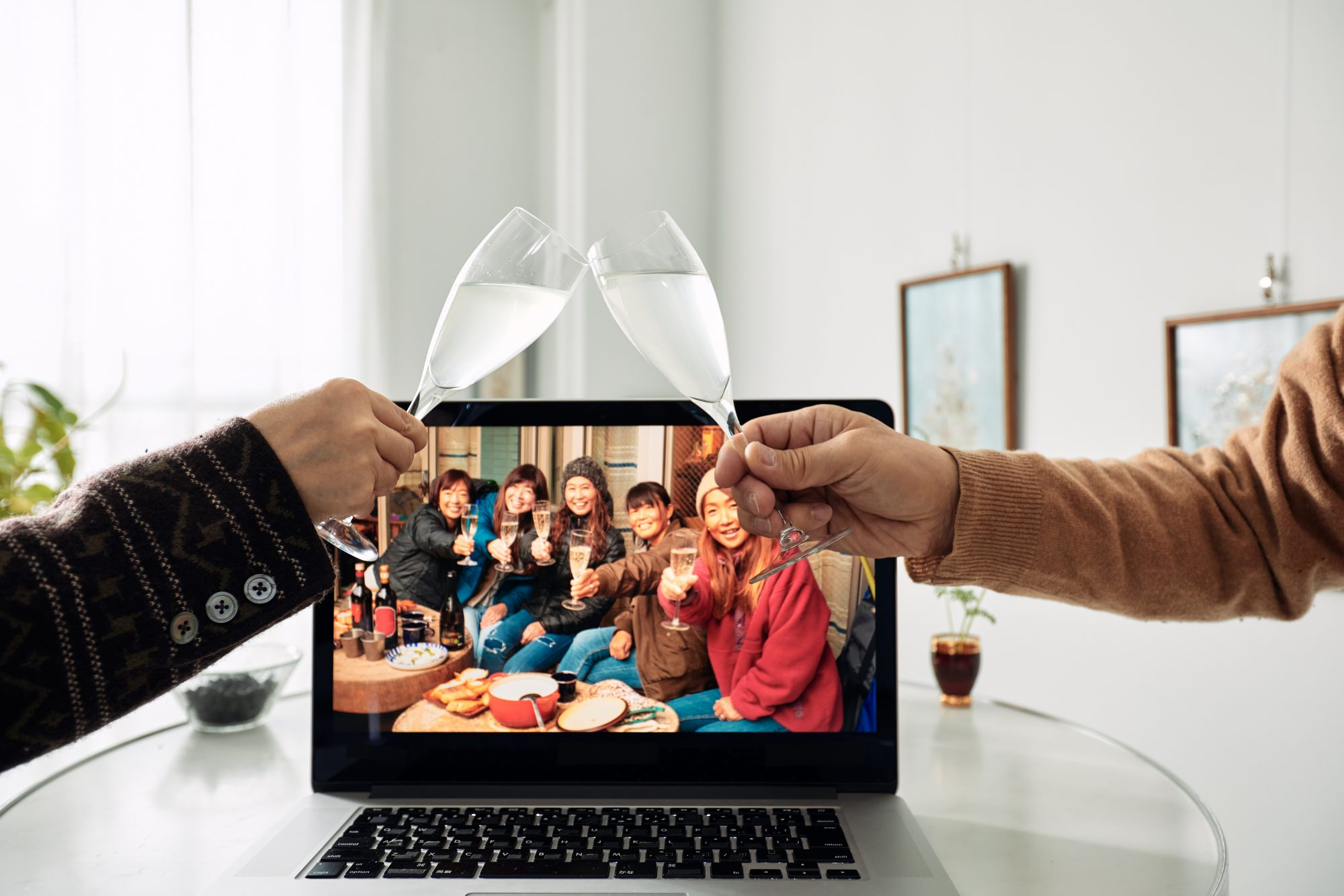Seniors toasting with glasses at a virtual holiday party with family