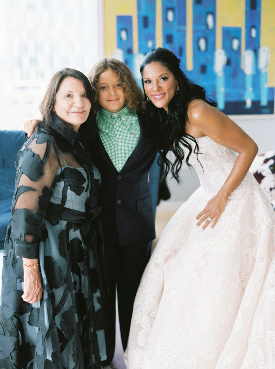 bride posing with her mother and son