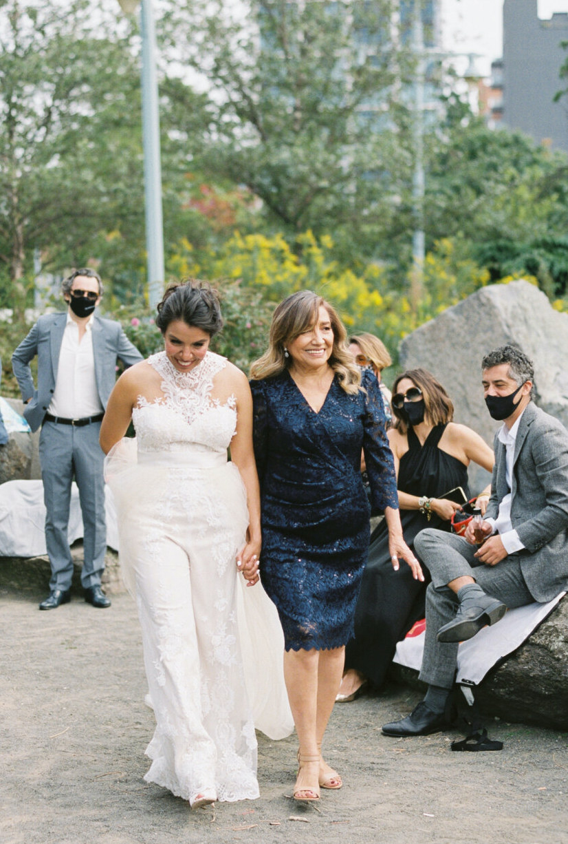 bride being escorted down aisle by mother