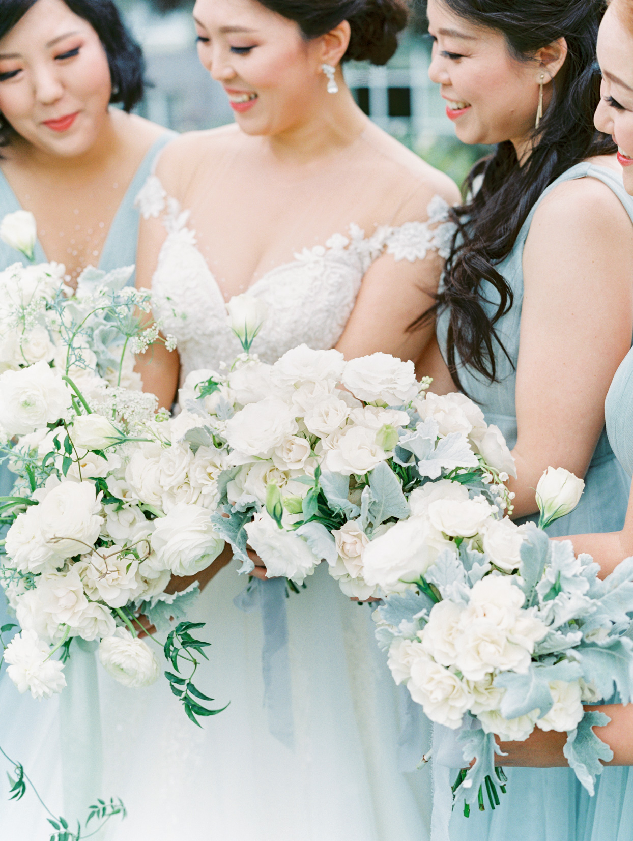 close up of white and blue wedding bouquets