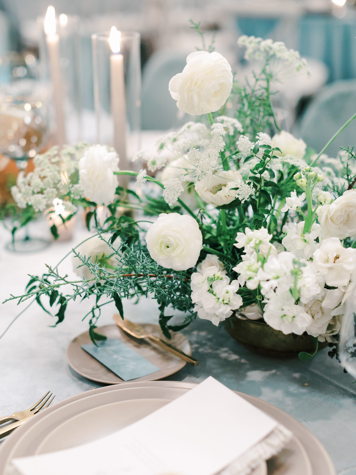 elegant white floral bouquets on blue wedding reception table