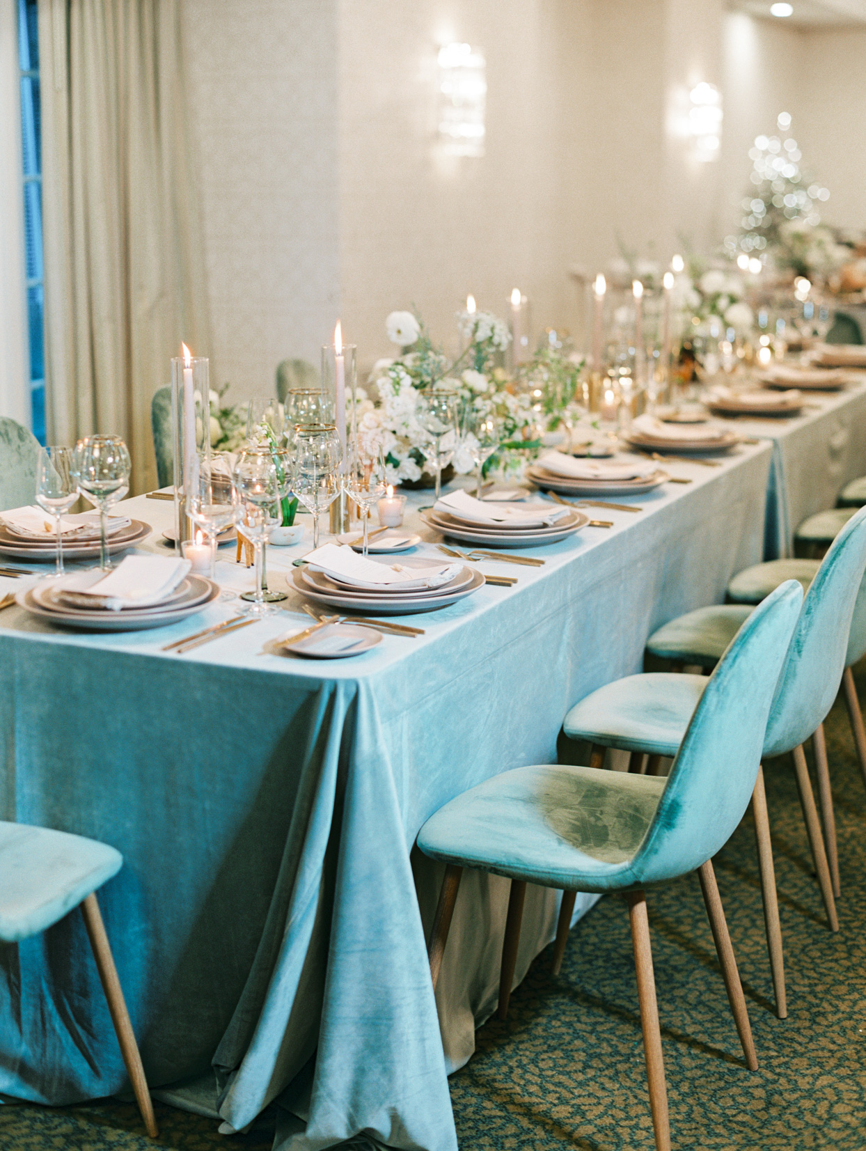long blue wedding tables with matching velvet chairs