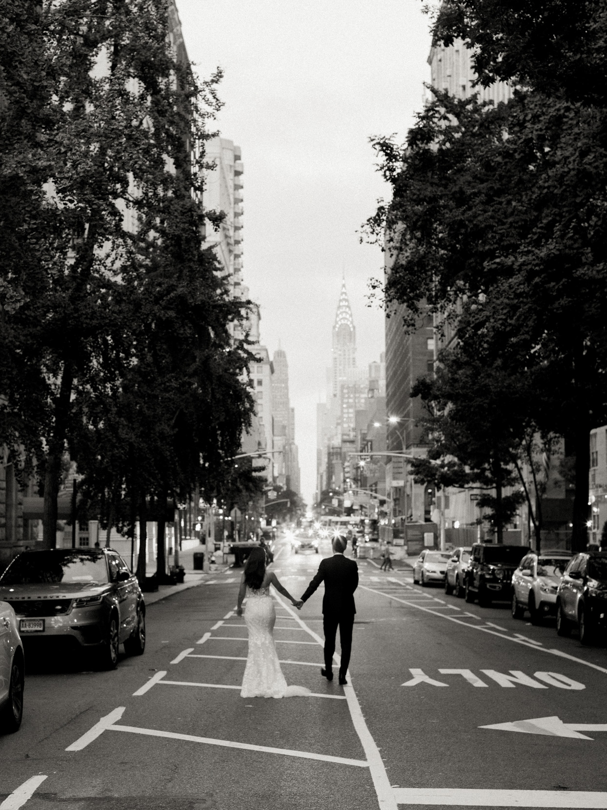 couple walking down nyc street hand in hand