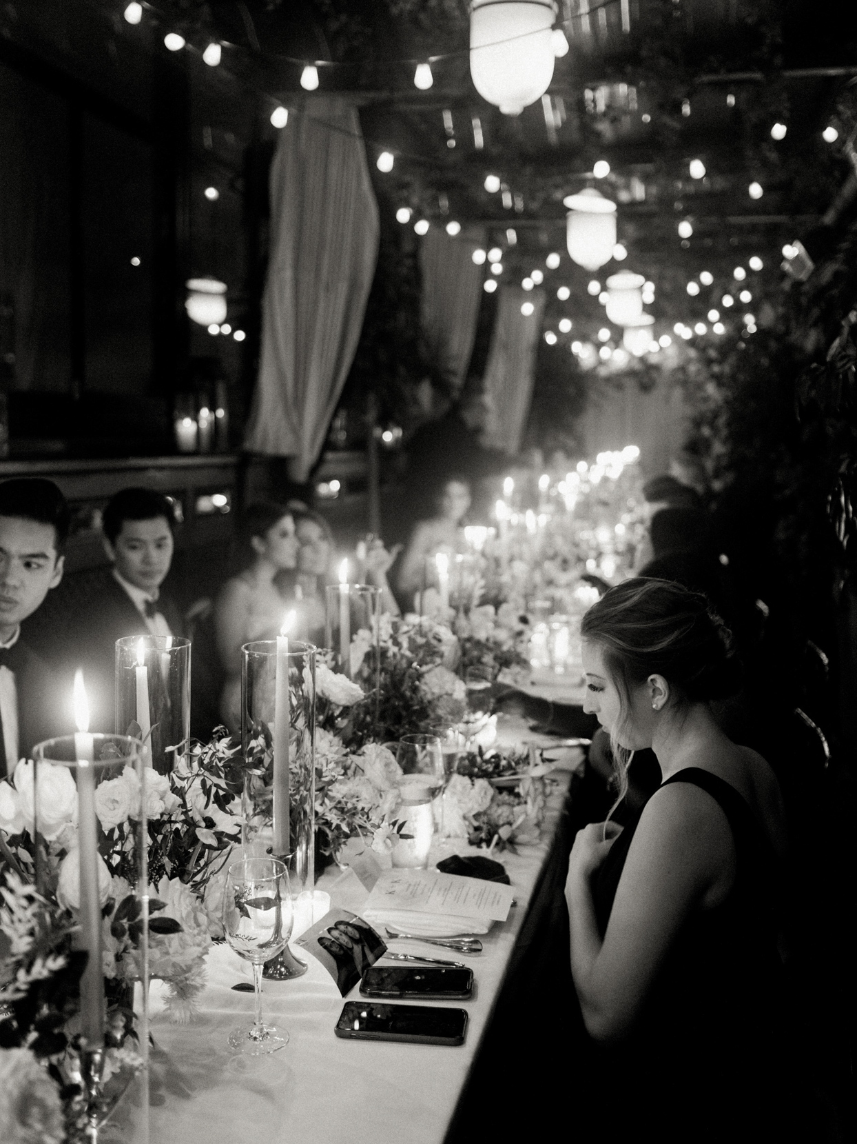guests sitting at long tables for reception dinner