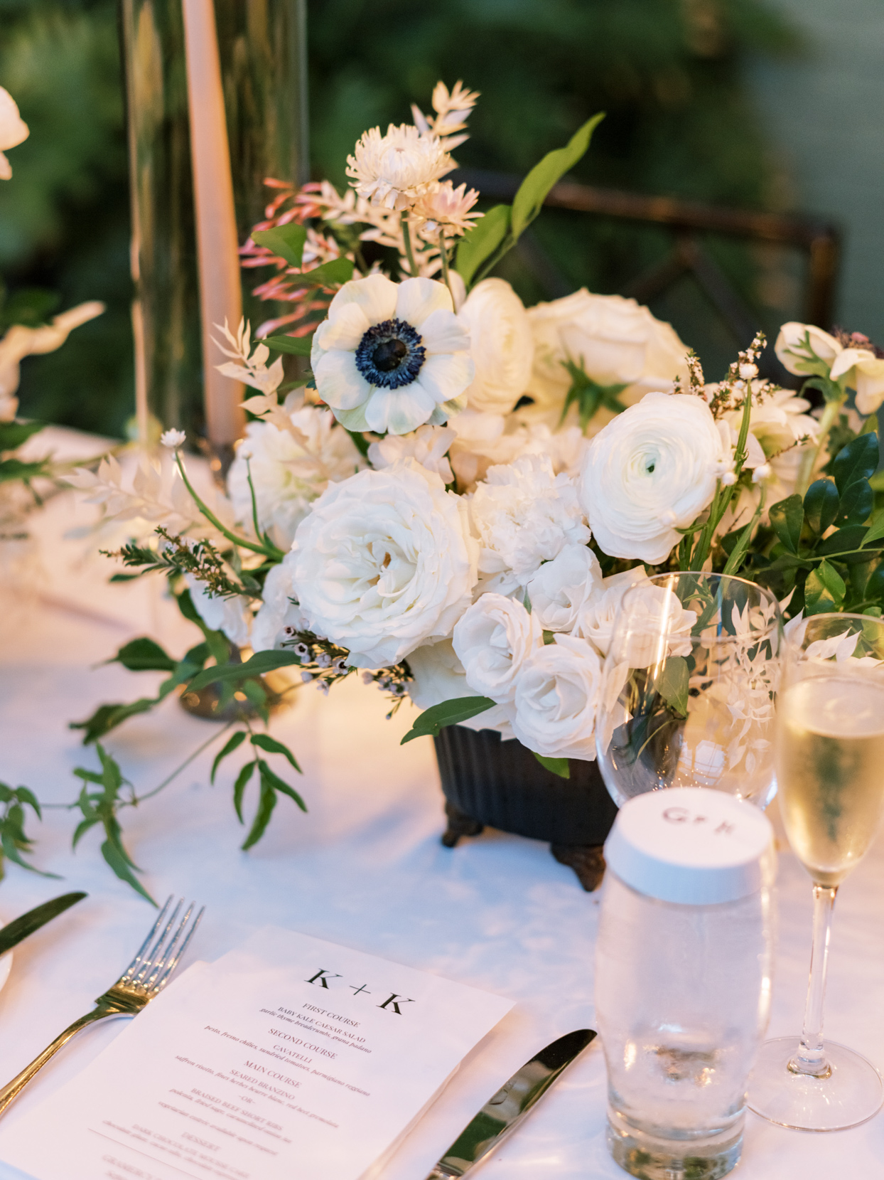 white bouquets on wedding reception tables