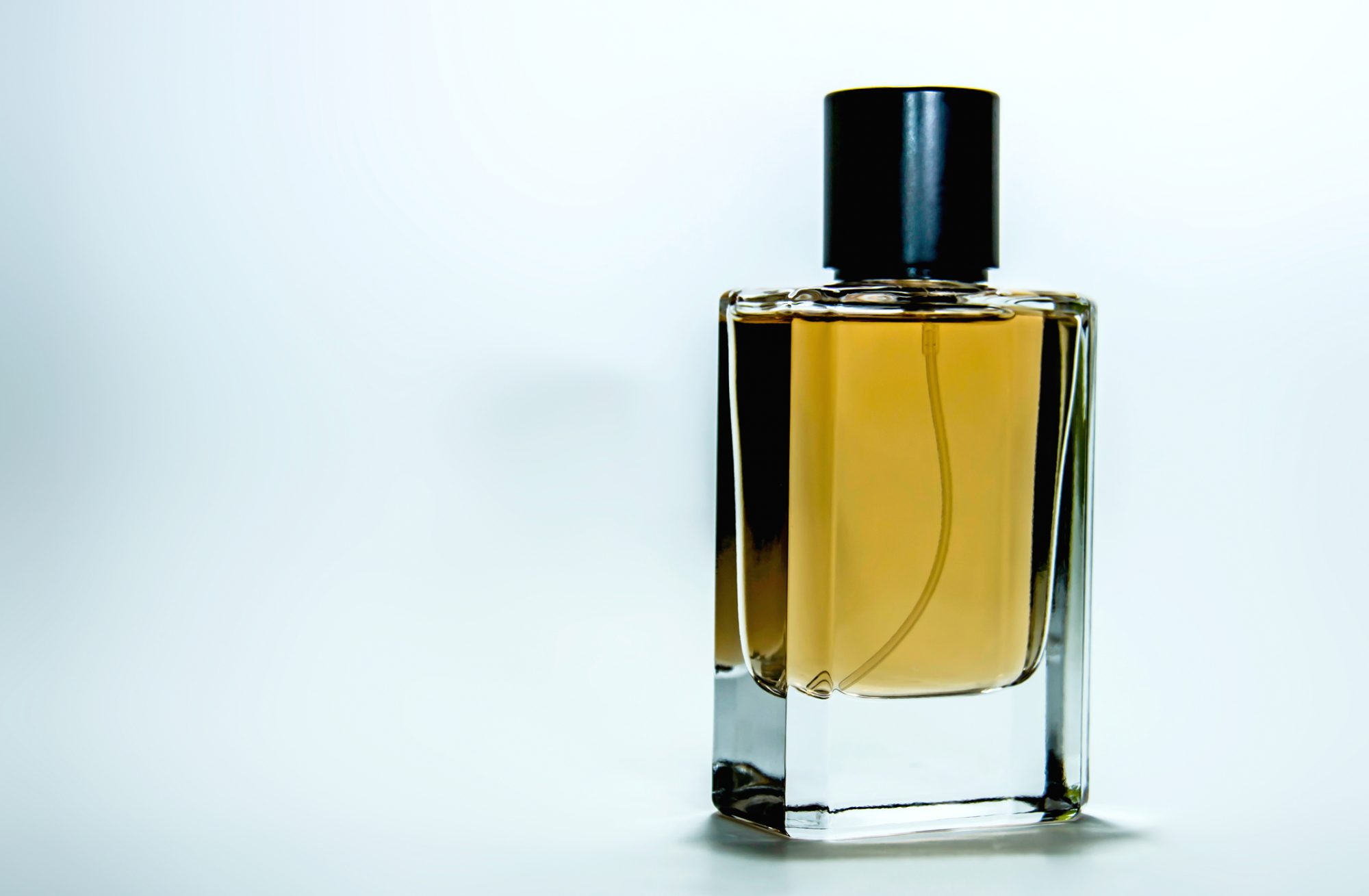 clear rectangle perfume bottle with black cap
