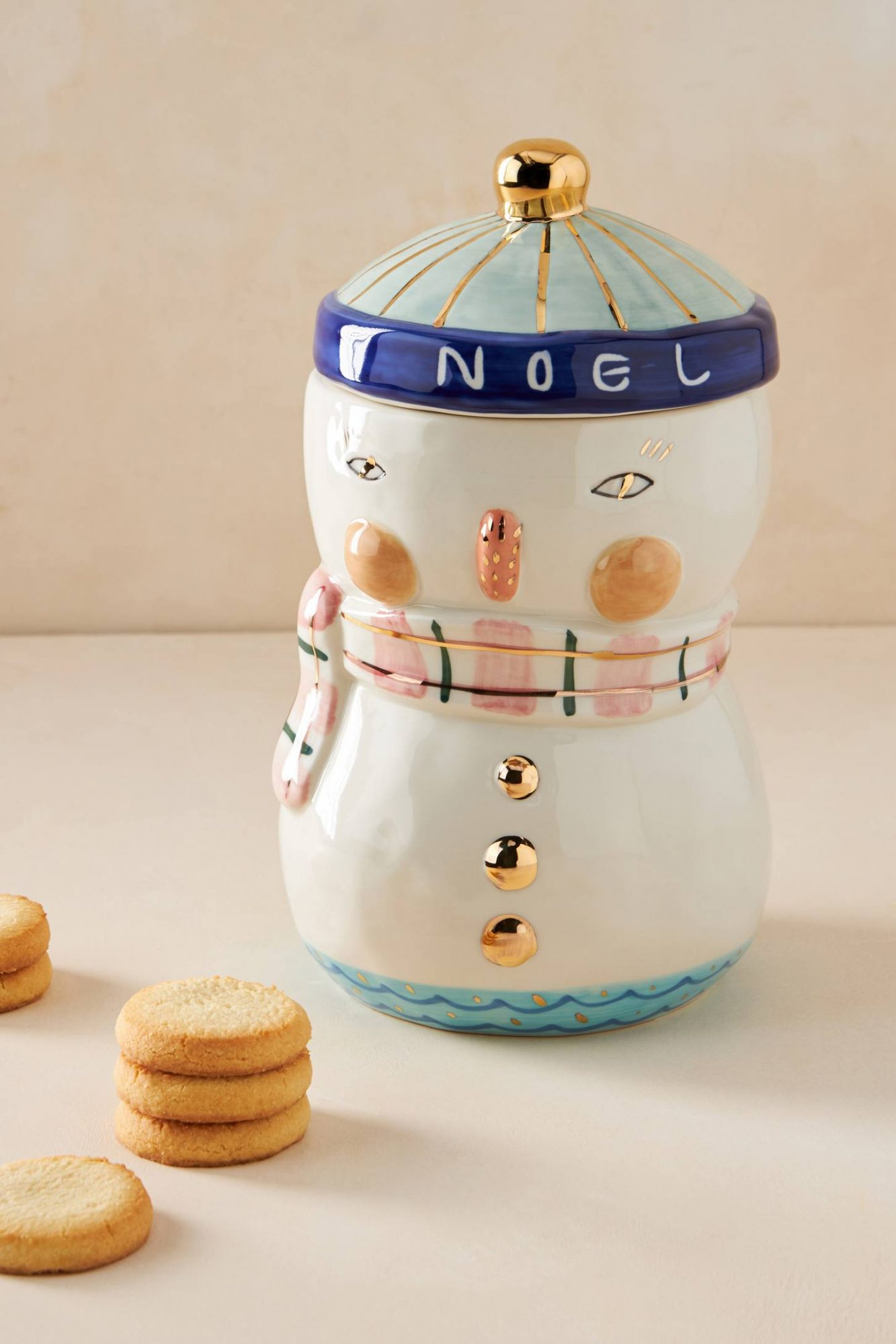 Even if you don't live in a snowy climate, you can still enjoy a white Christmas with this sweet-as-can-be snowman cookie jar. Instead of snow, this snowman is made of stoneware and will look great on your countertop all winter long.                             Shop Now: BIRDCANFOX Joyeux Noel Snowman Cookie Jar, $58, anthropologie.com.