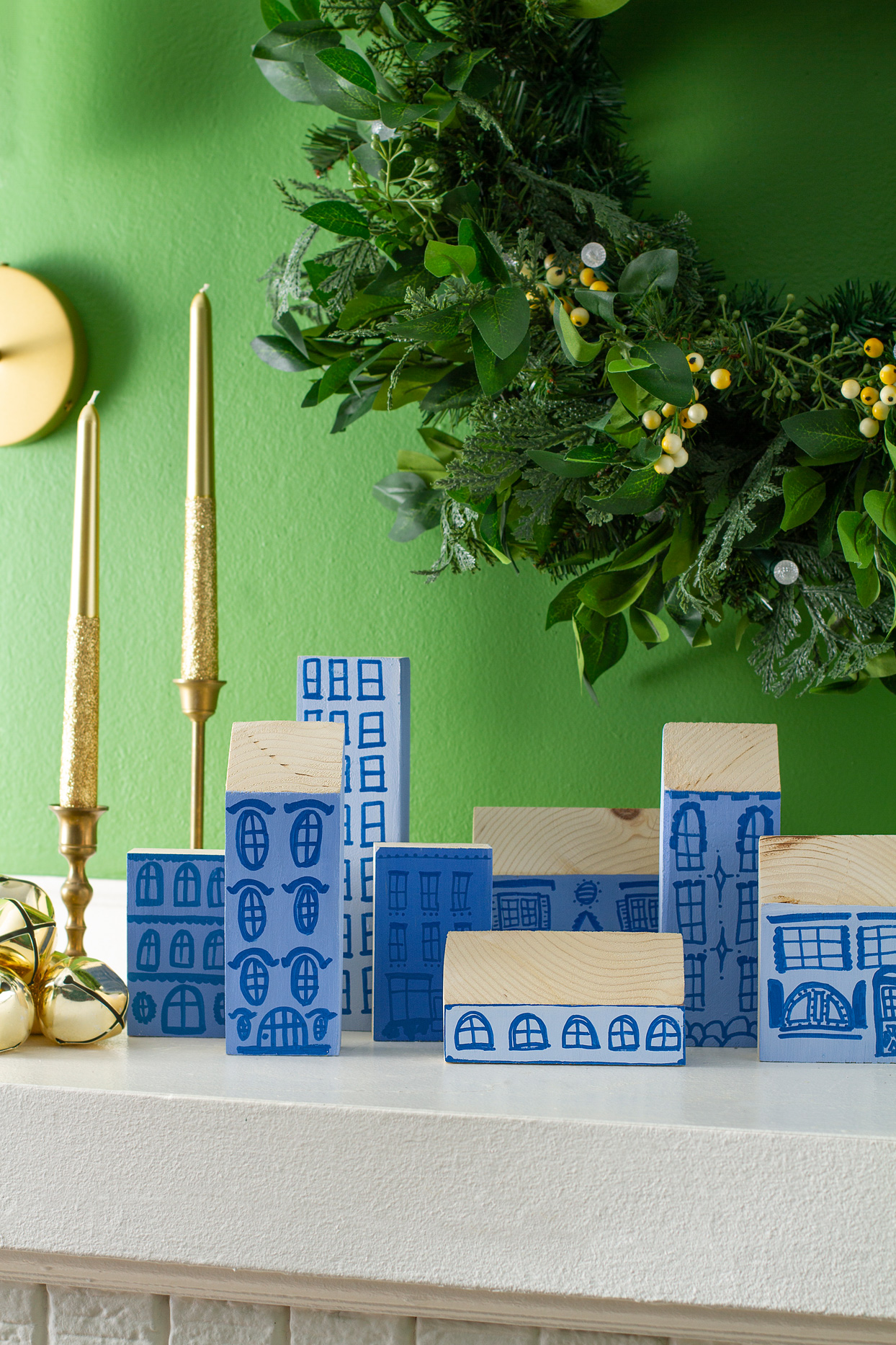blue wooden village atop mantel