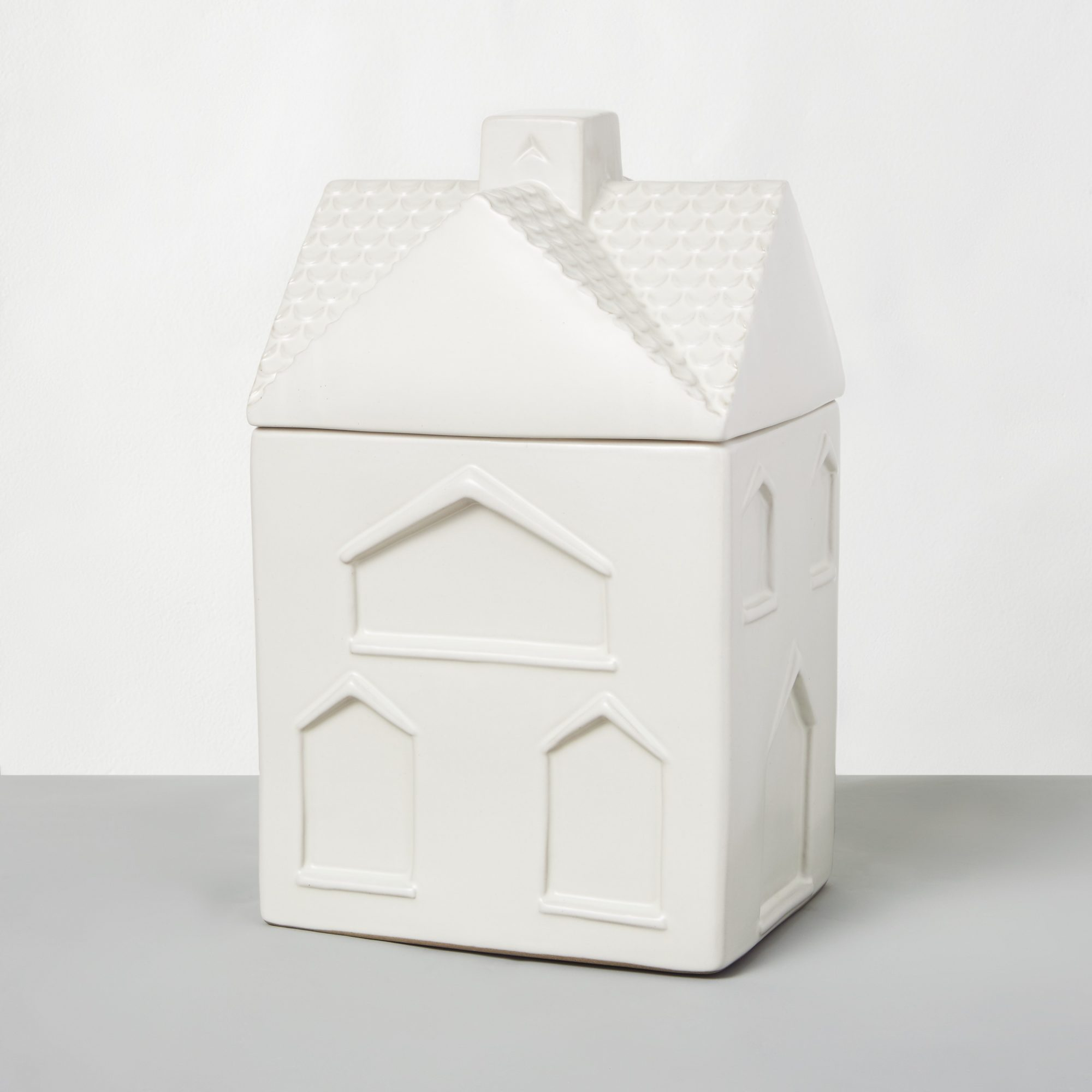 Store Christmas cookies in an adorable jar that resembles a gingerbread house, which has a total capacity of 102 ounces. When you finish eating homemade cookies from the jar, hand wash it to preserve the glazed finish and fine details.                             Shop Now: Stoneware House Cookie Jar Sour Cream–Hearth & Hand™ with Magnolia, $19.99, target.com.