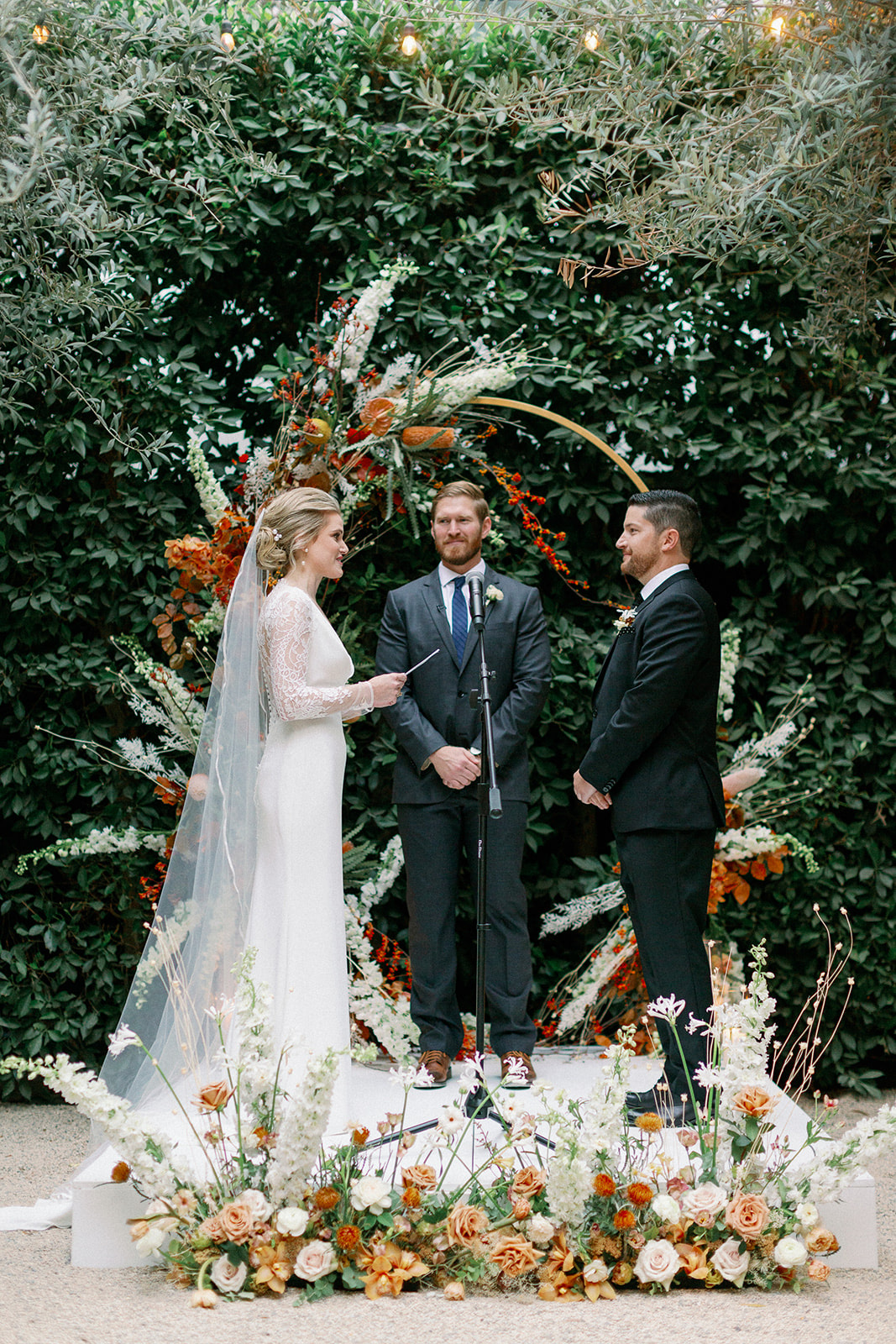 wedding couple exchanging vows in front of Ikebana-Style Floral arch