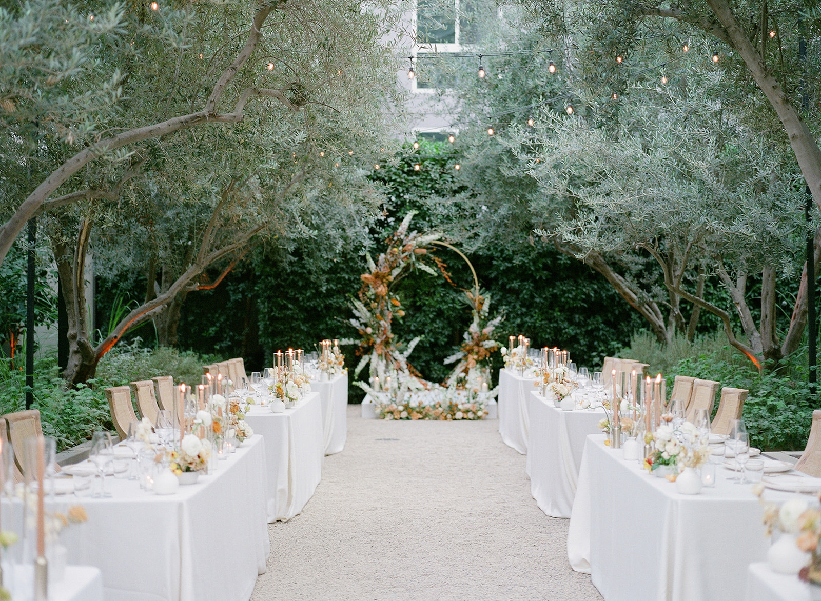 wedding ceremony outdoor garden space with tables for guests