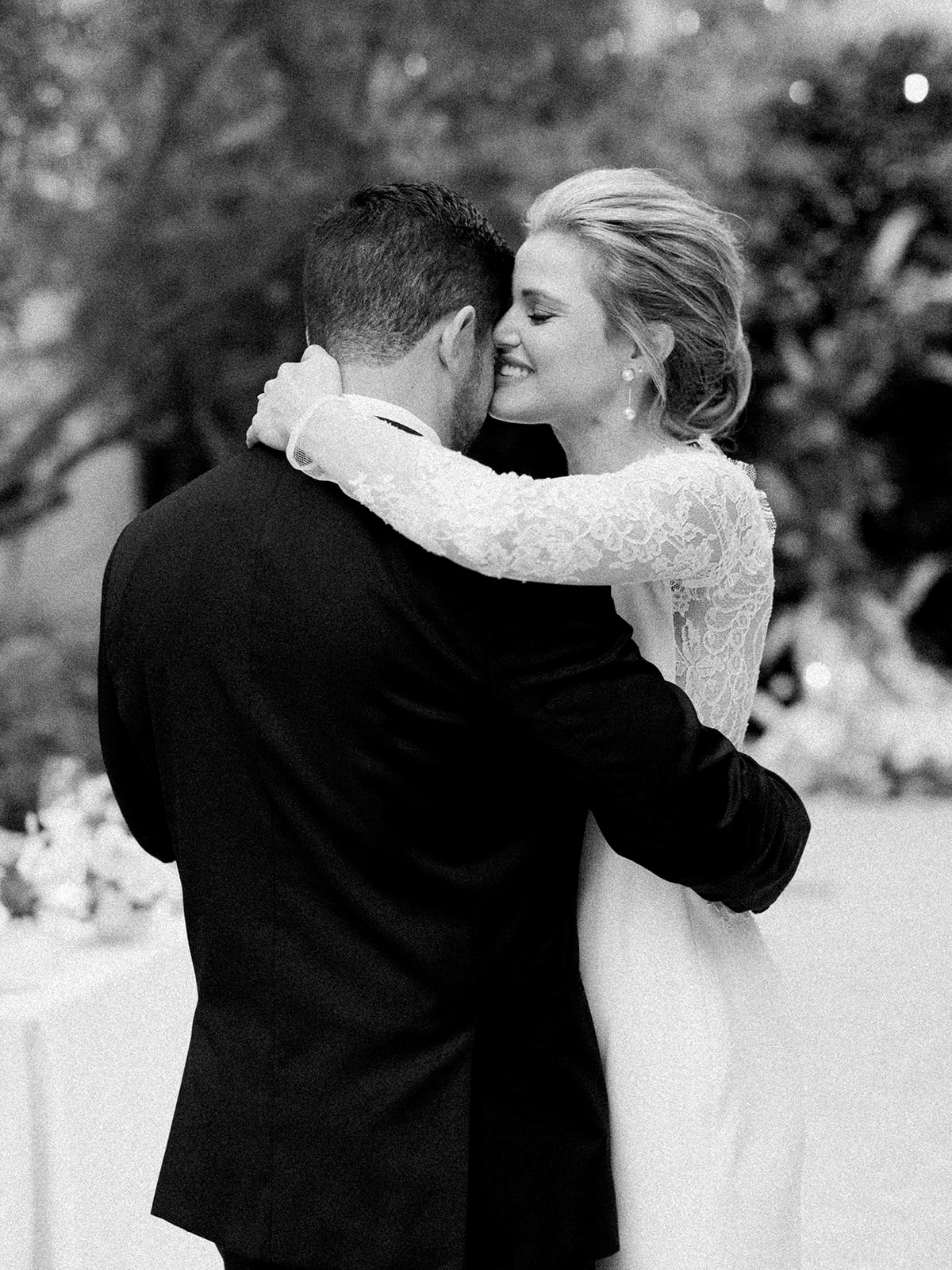 couple embracing for first dance