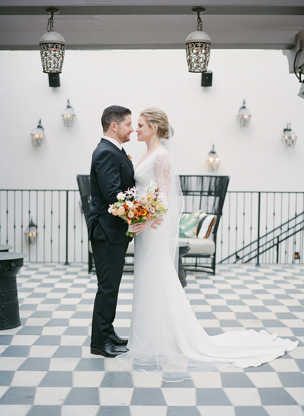 couple portrait in restaurant lobby during first look