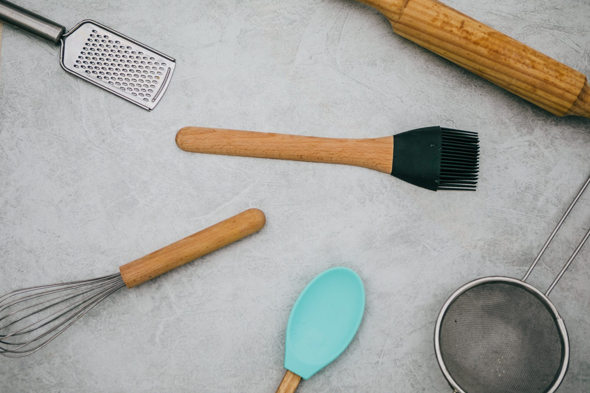 whisk, grater, and other baking utensils