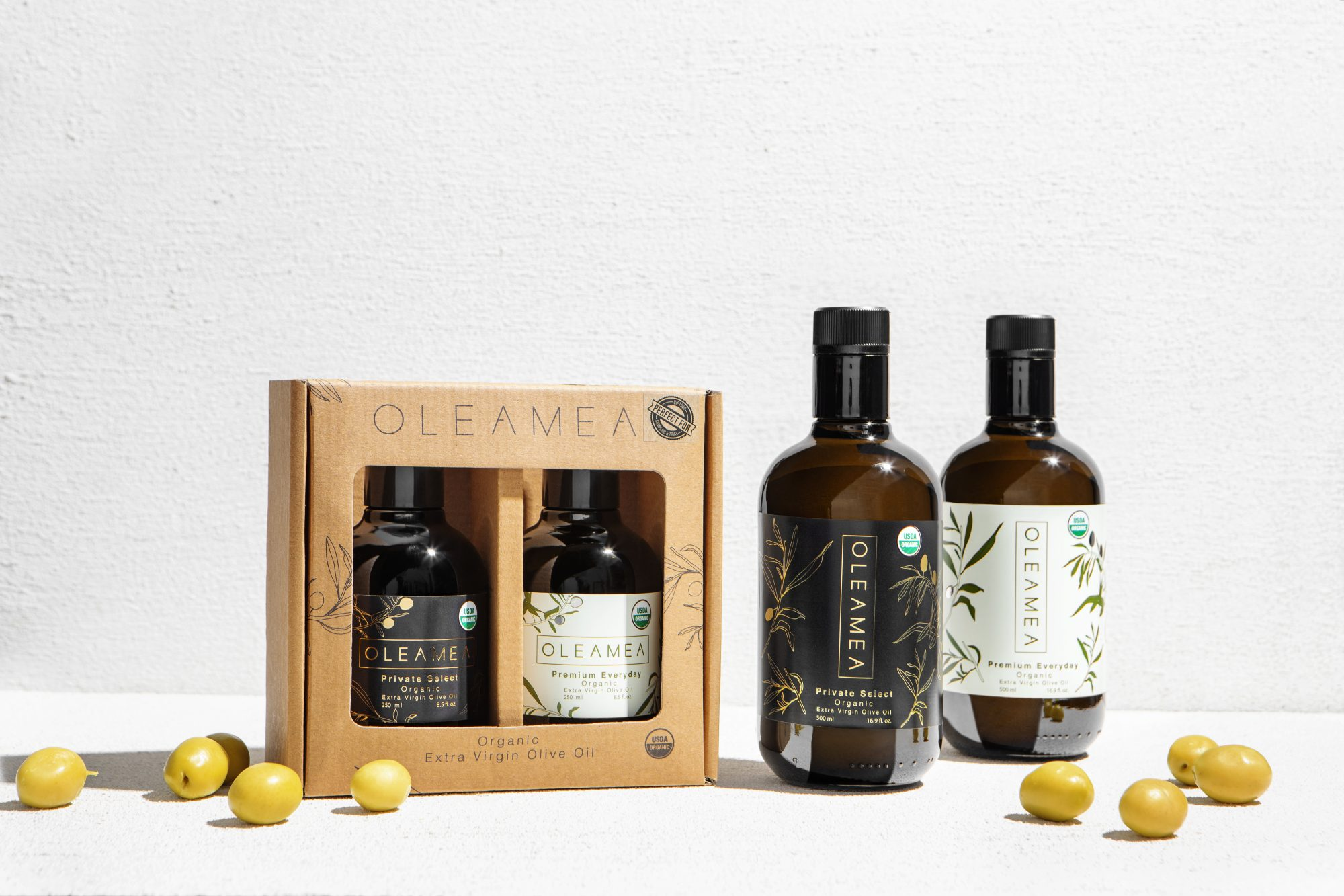 oleamea olive oil set surrounded by lemons