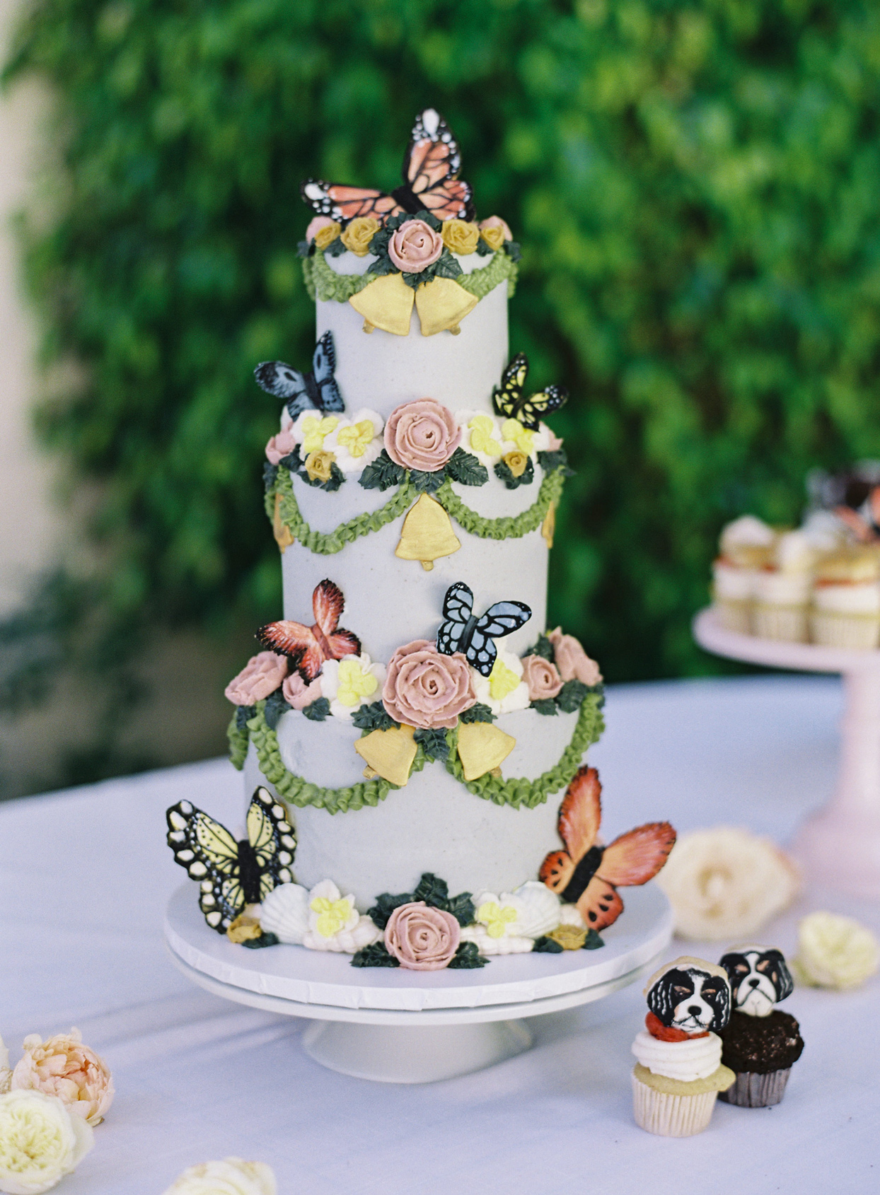 floral and butterfly decorated wedding cake