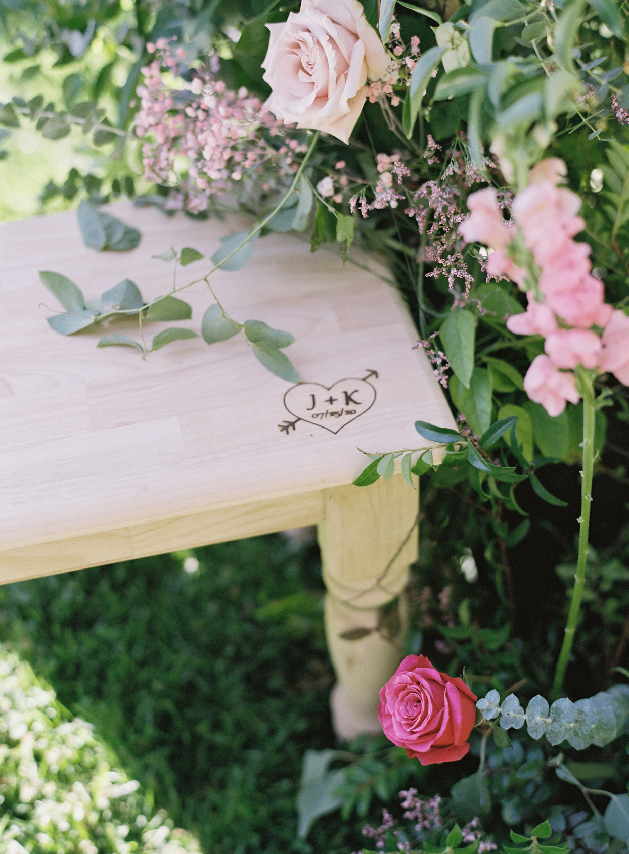 J+K engraved on wooden wedding bench