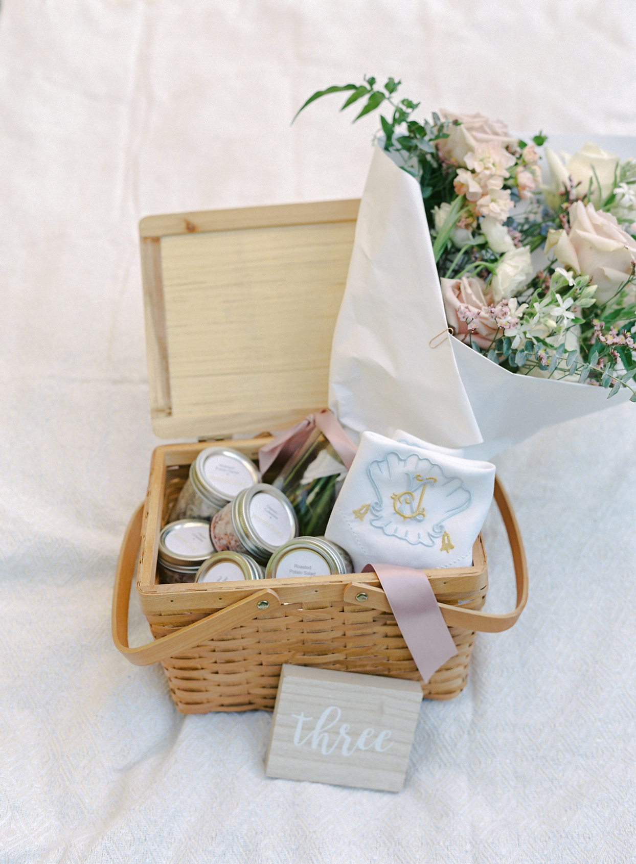 wicker picnic basket with floral bouquet