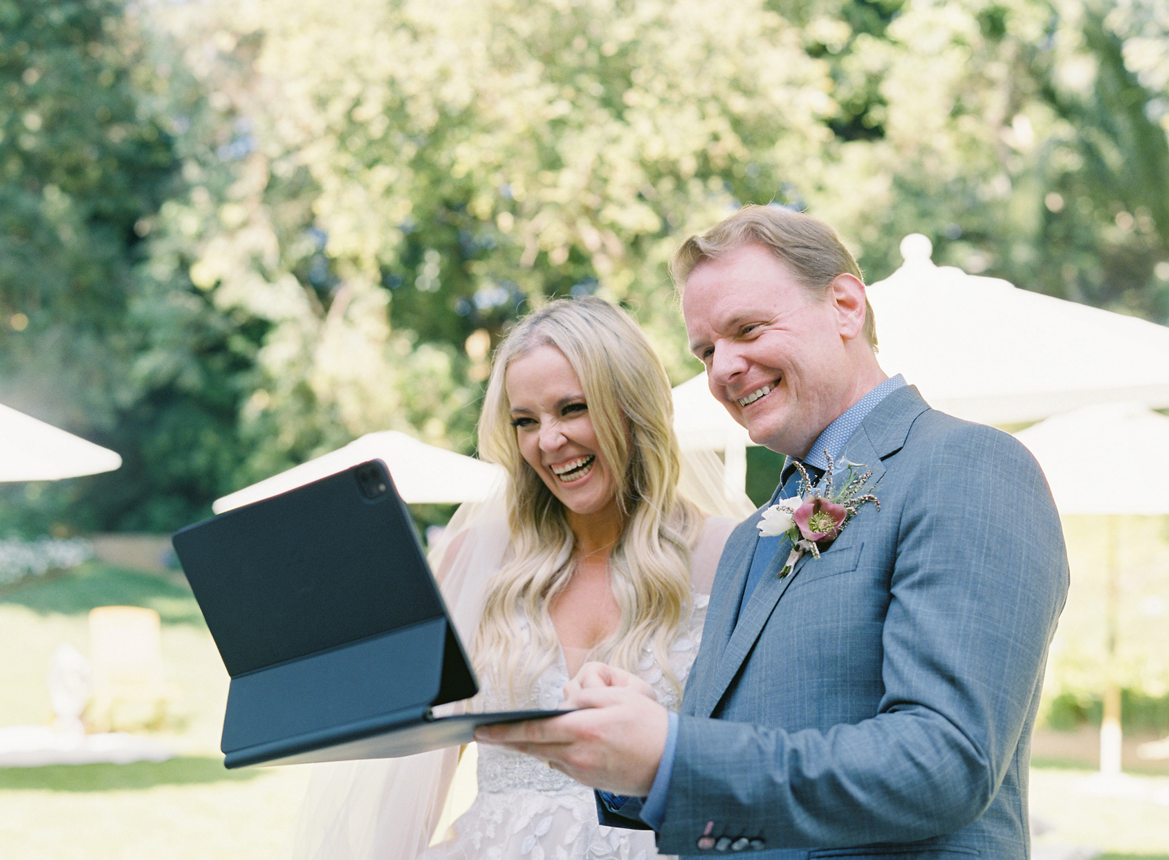 bride and groom virtually celebrating with guest over video