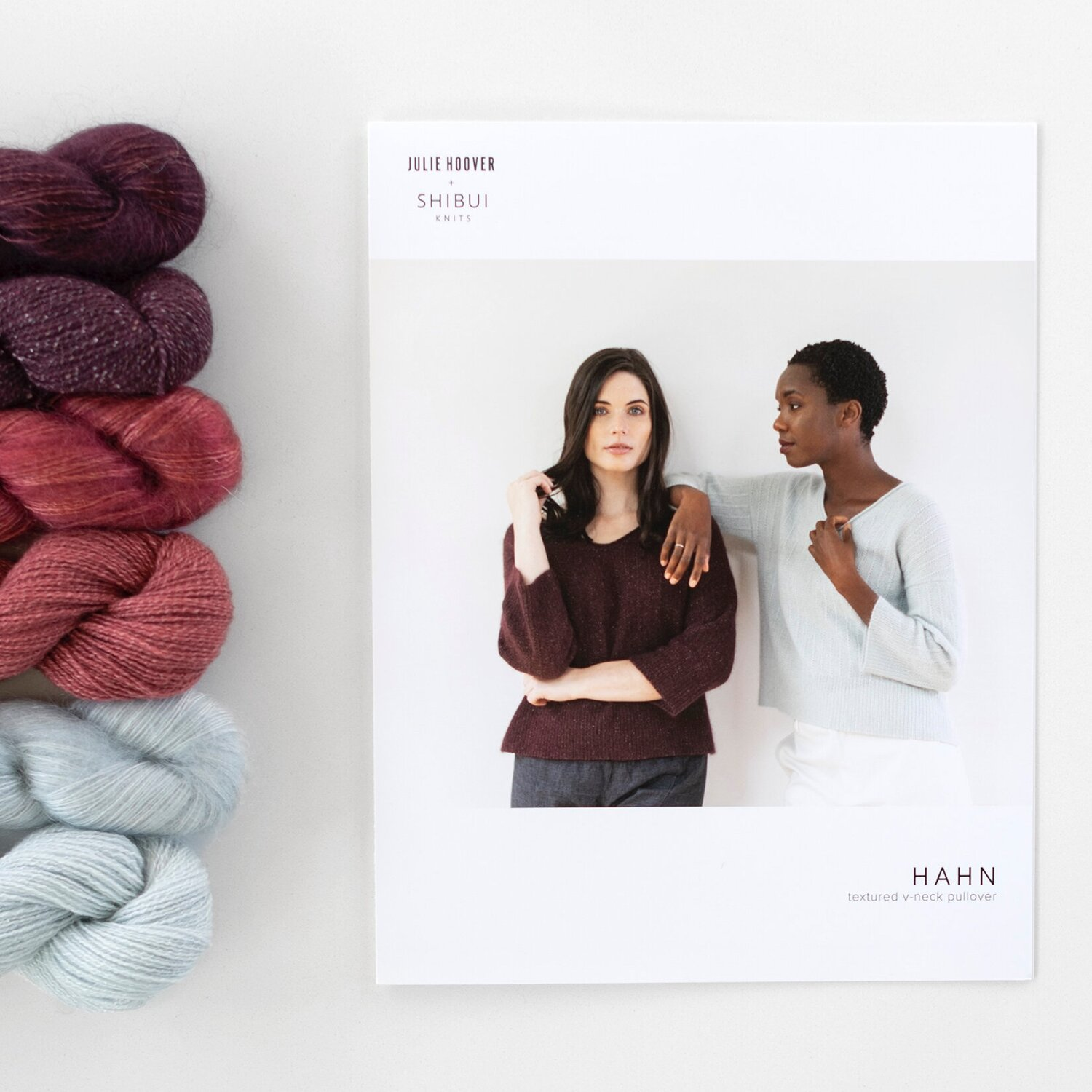 Red, purple, and gray yarns