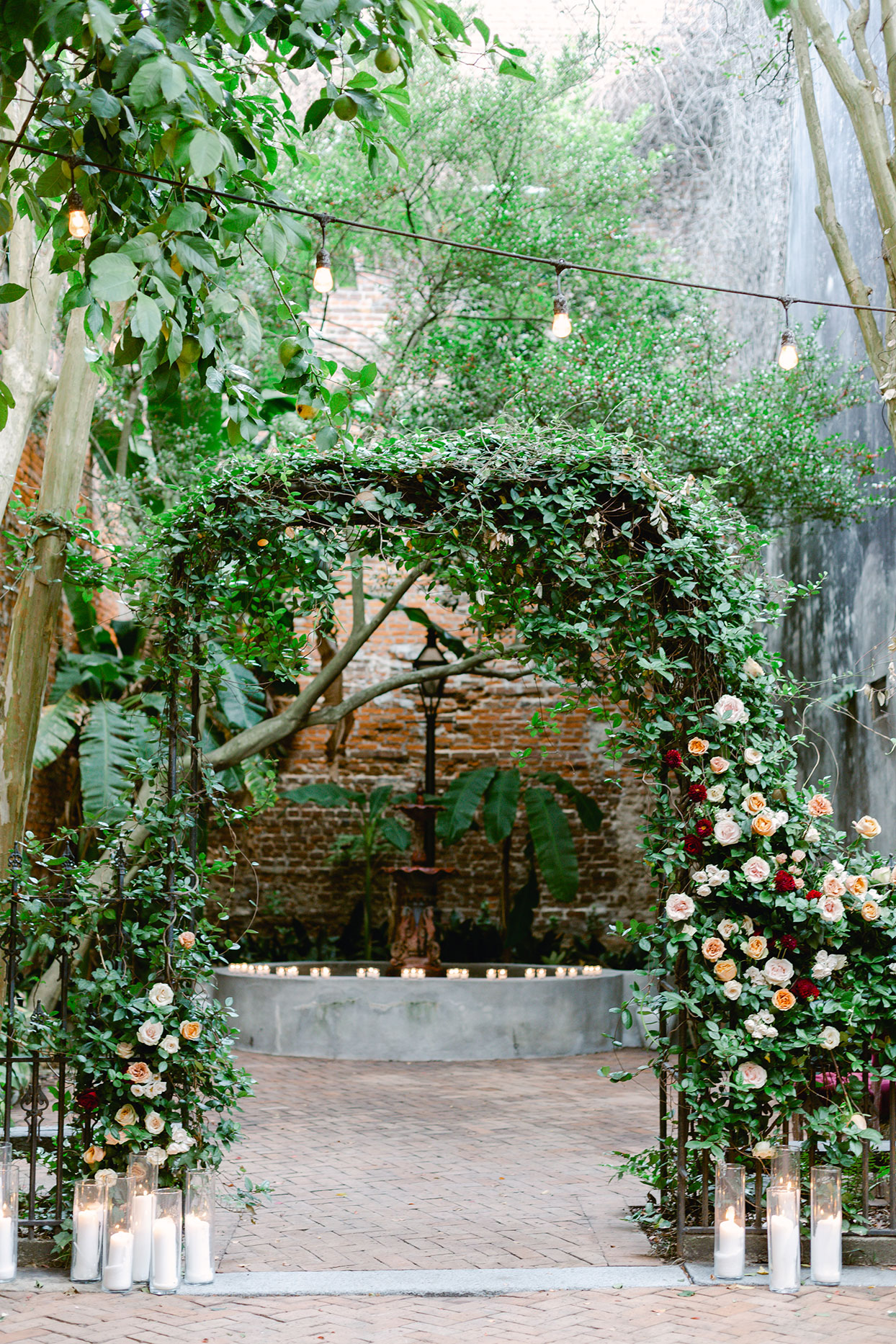large greenery and floral wedding arch