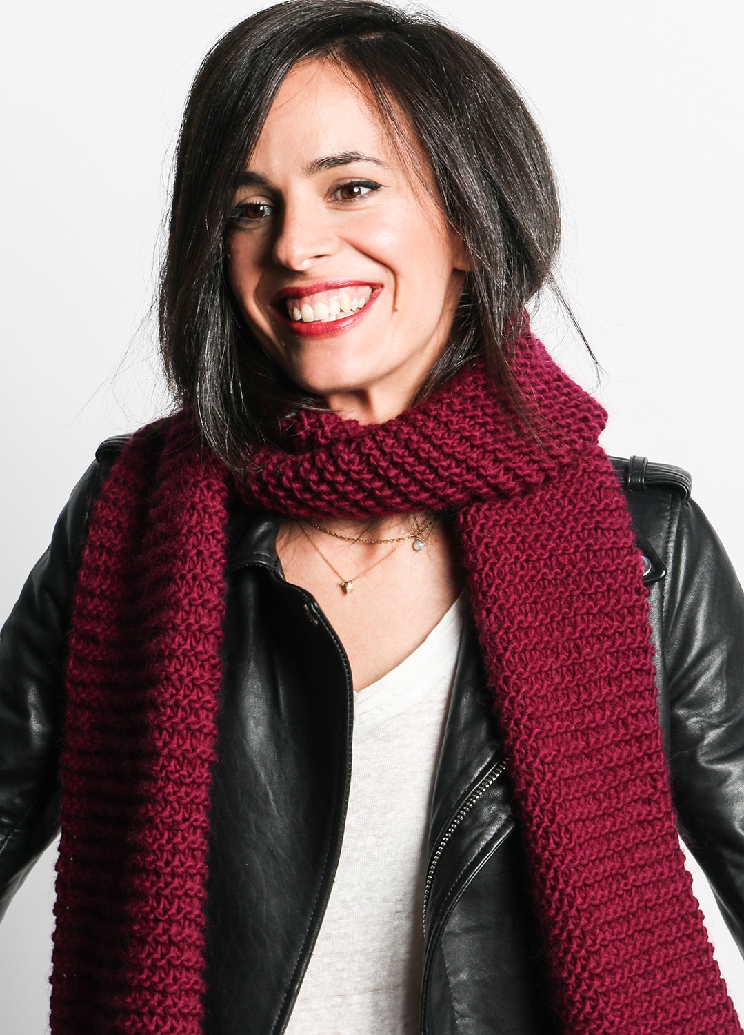 Woman wearing maroon-colored knit scarf