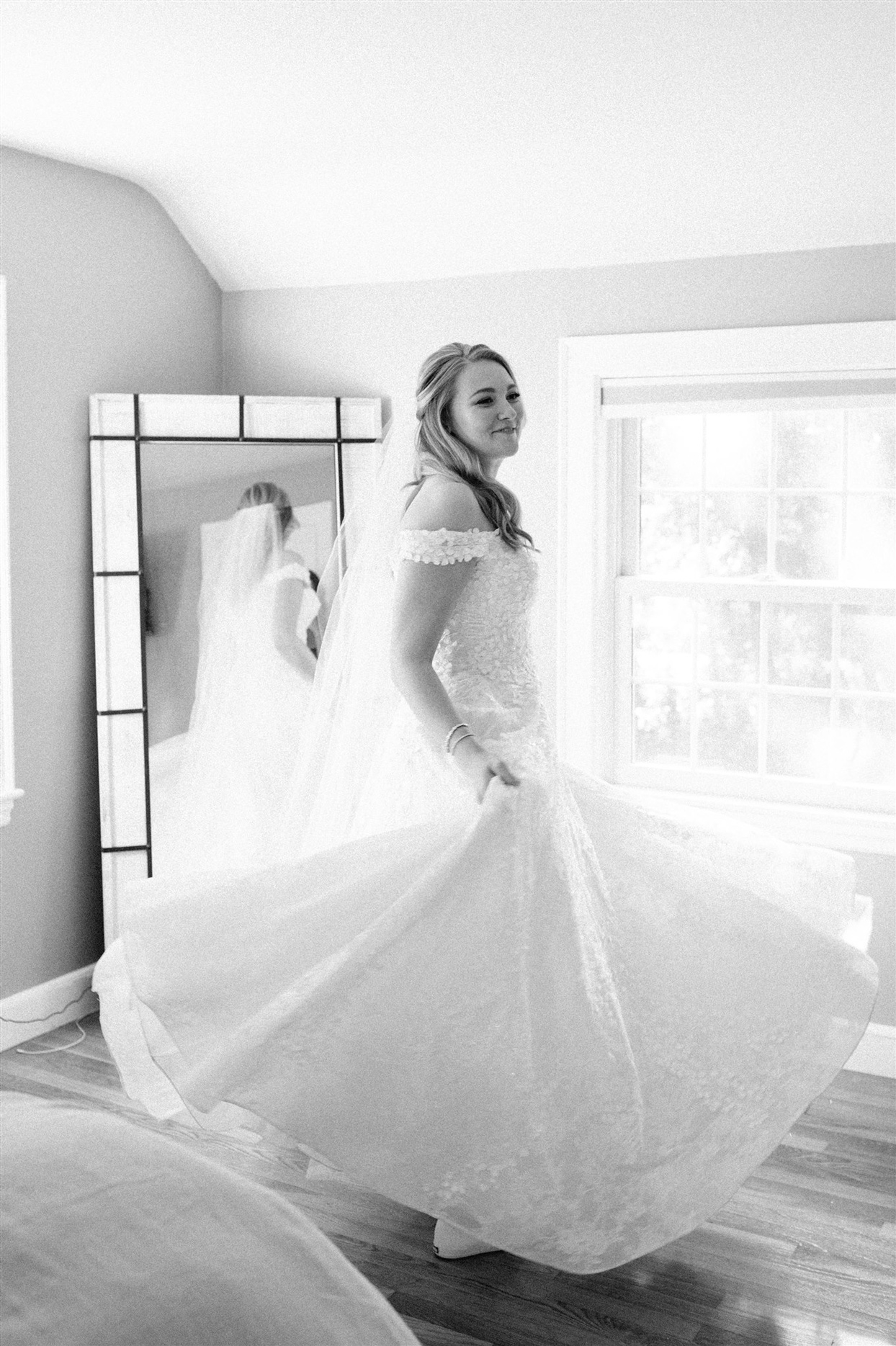 Bride spinning in wedding dress while getting ready