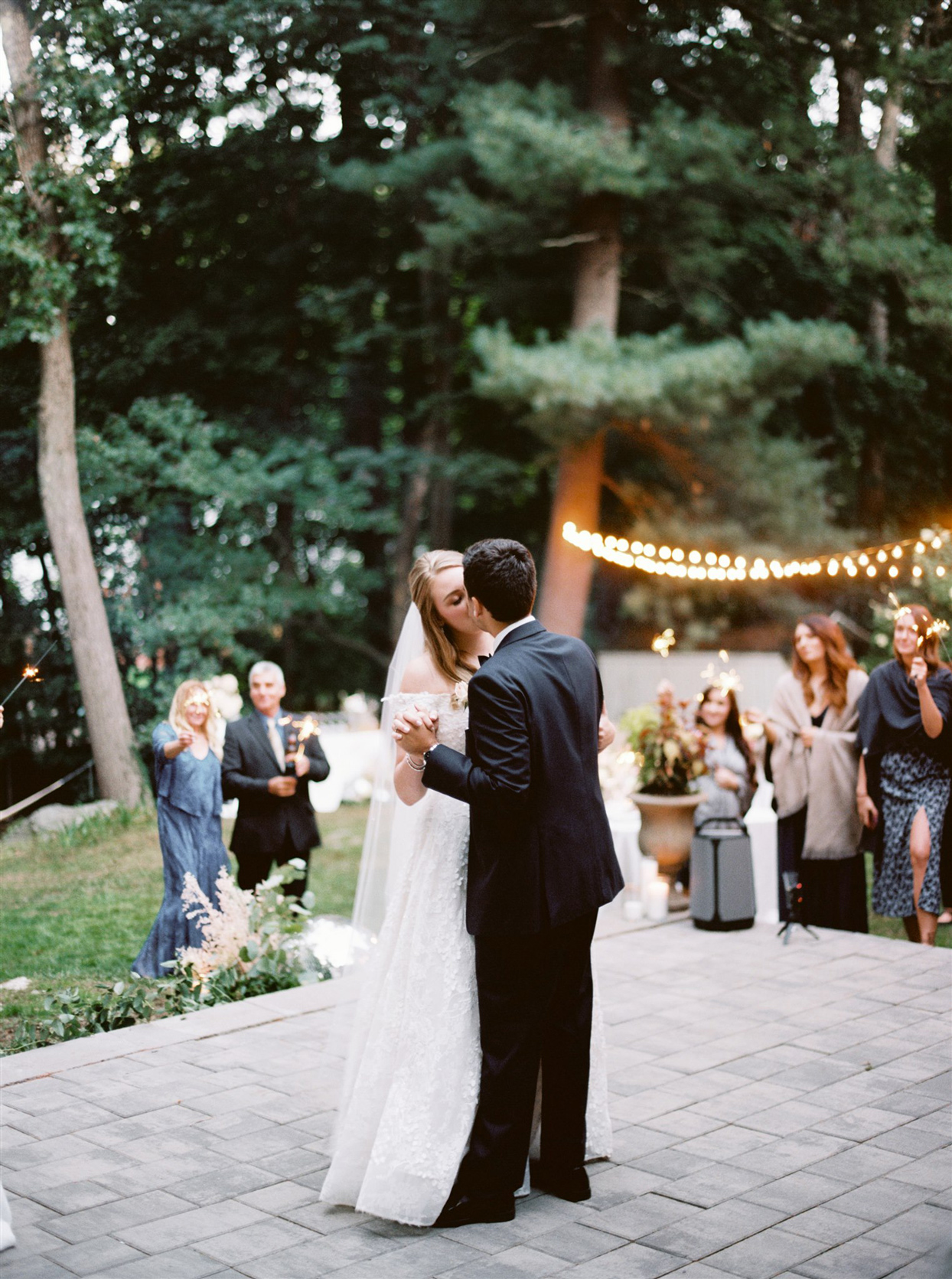 Bride and groom first dance on patio