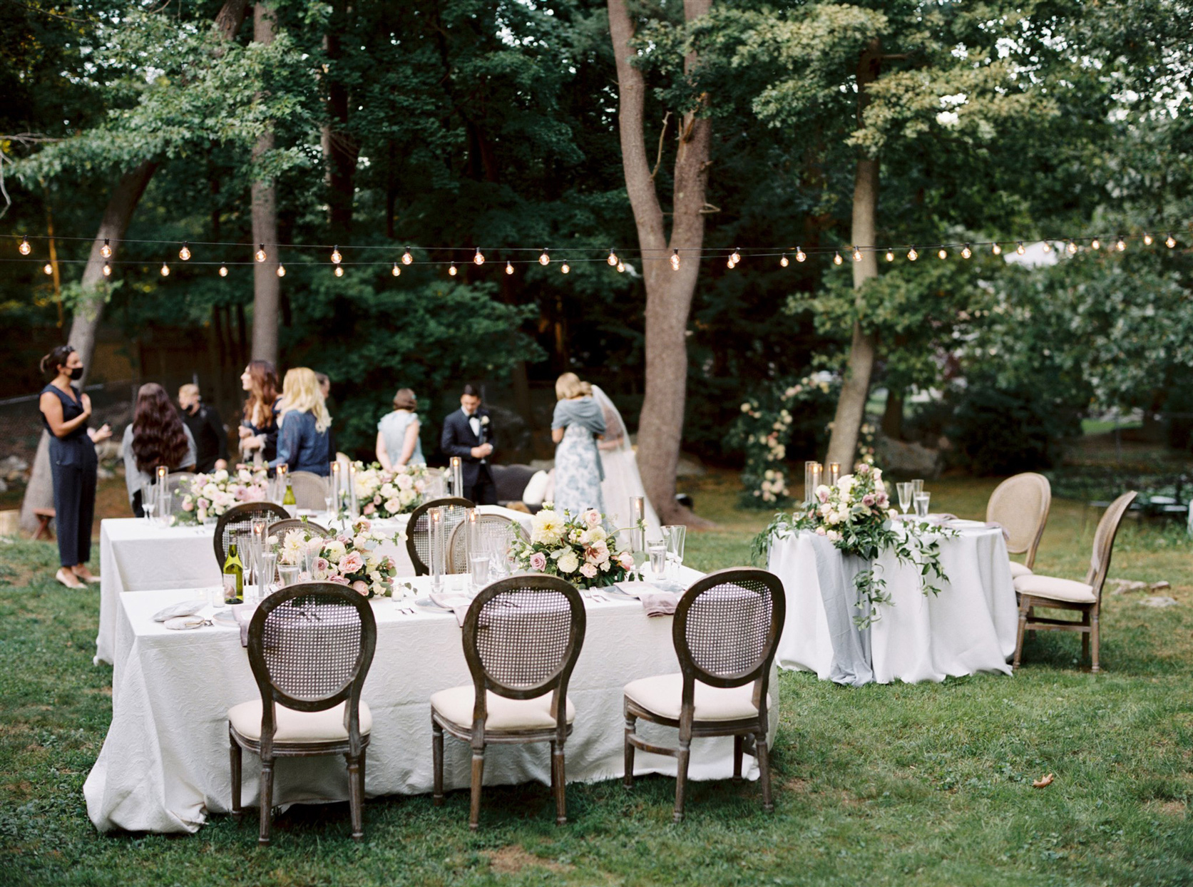 Backyard with decorated tables and string lights