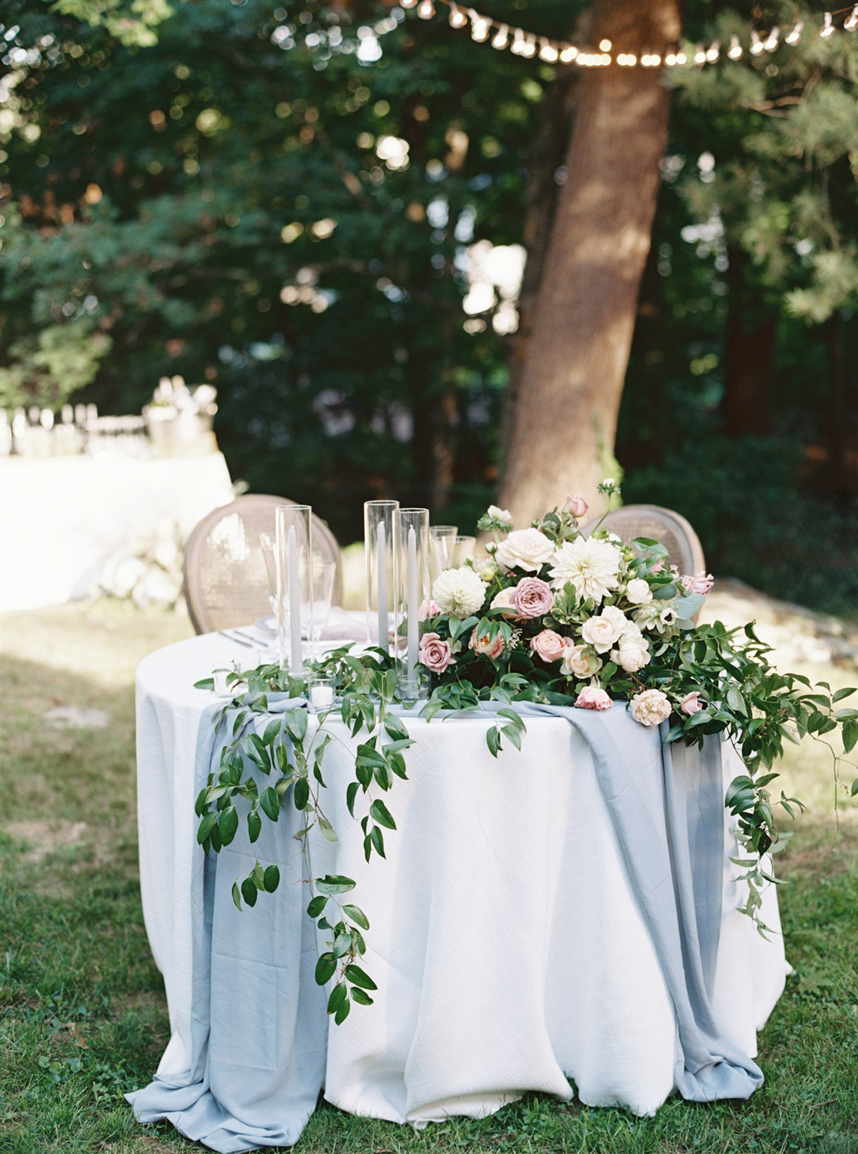 Bride and groom table setting with floral arrangement