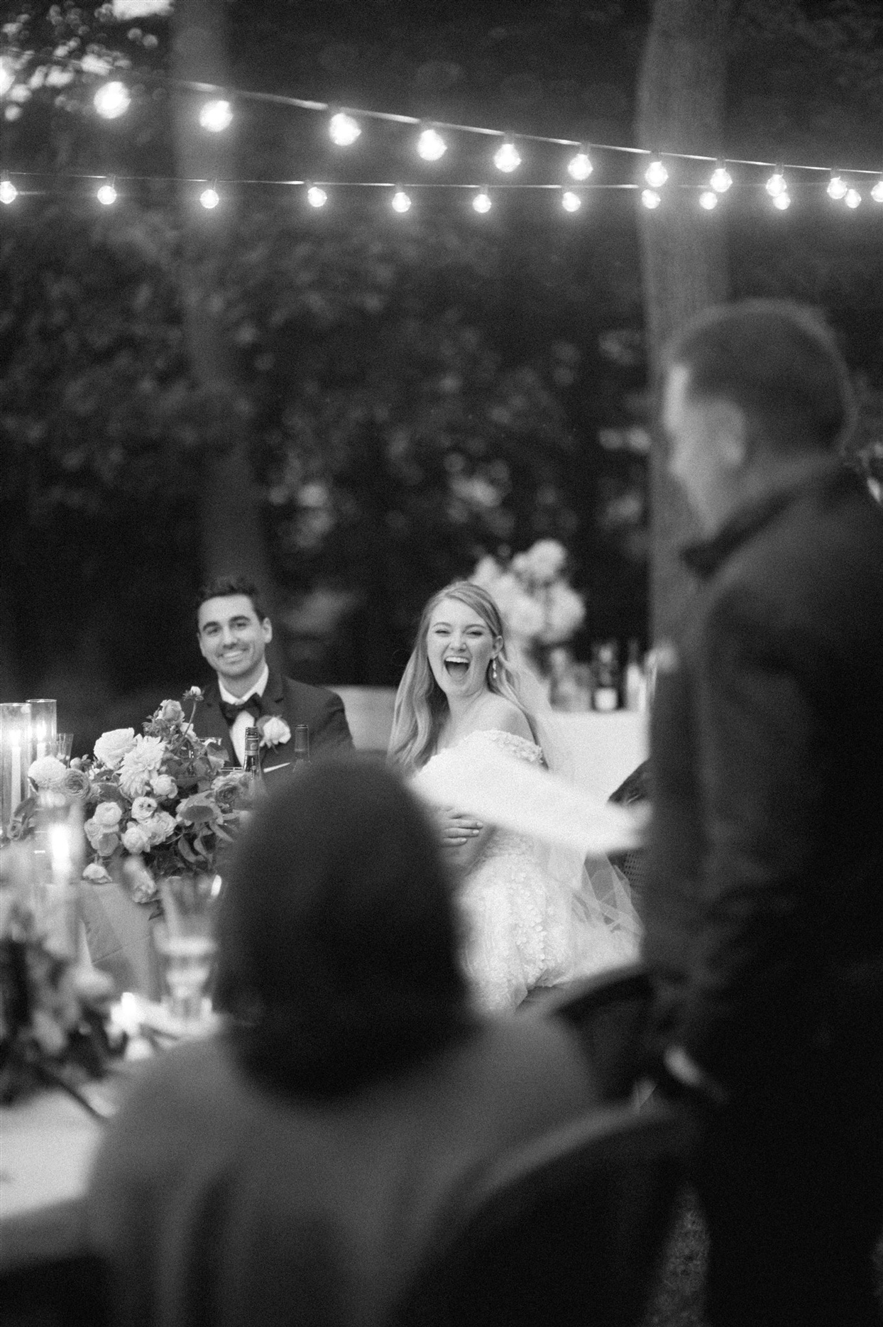Bride and groom sharing toasts