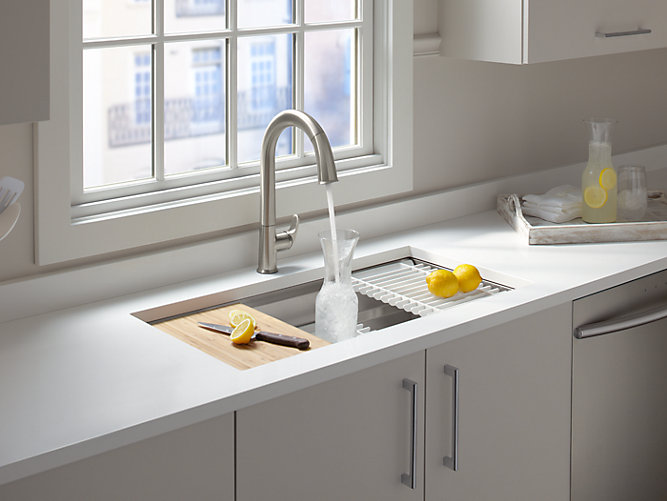 sink with cutting board and drying rack