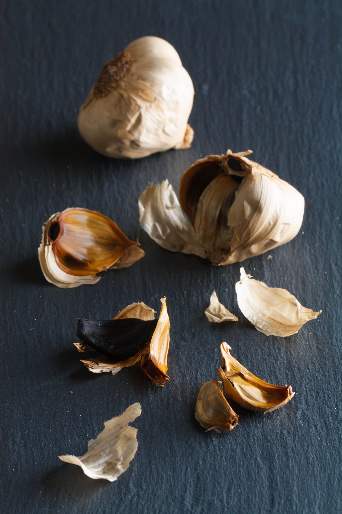 cloves and heads of black garlic