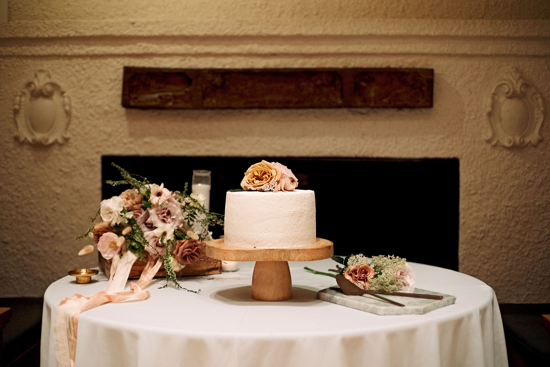 White frosted wedding cake with flora accents