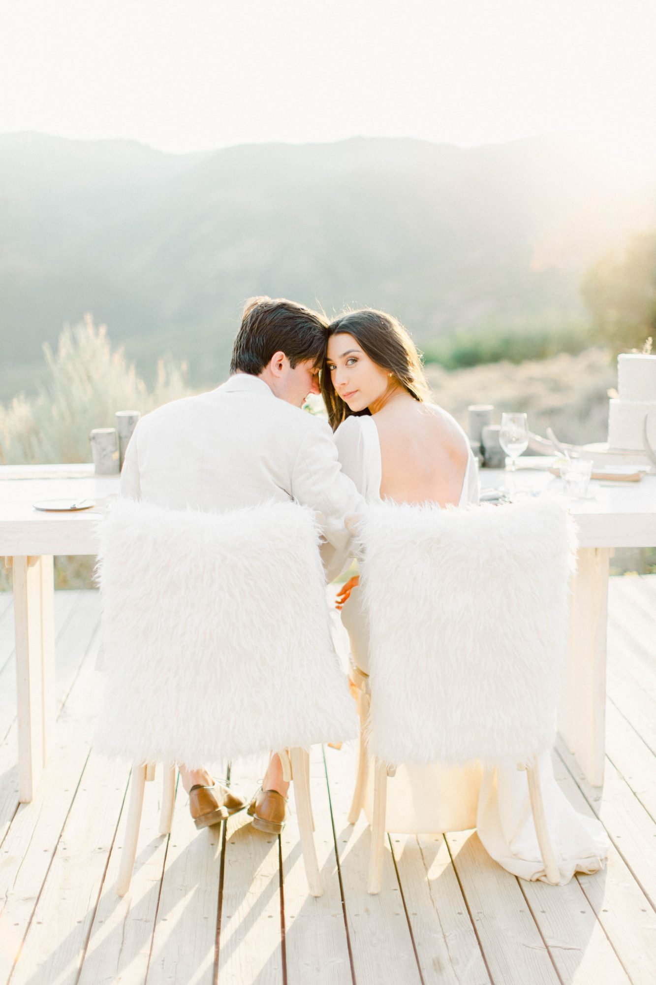 Bride and groom seated at table